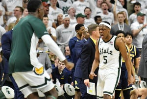 Michigan State guard Cassius Winston (5) reacts in the second half Saturday. Winston finished with 23 points in the Spartans' 75-63 victory over Michigan.