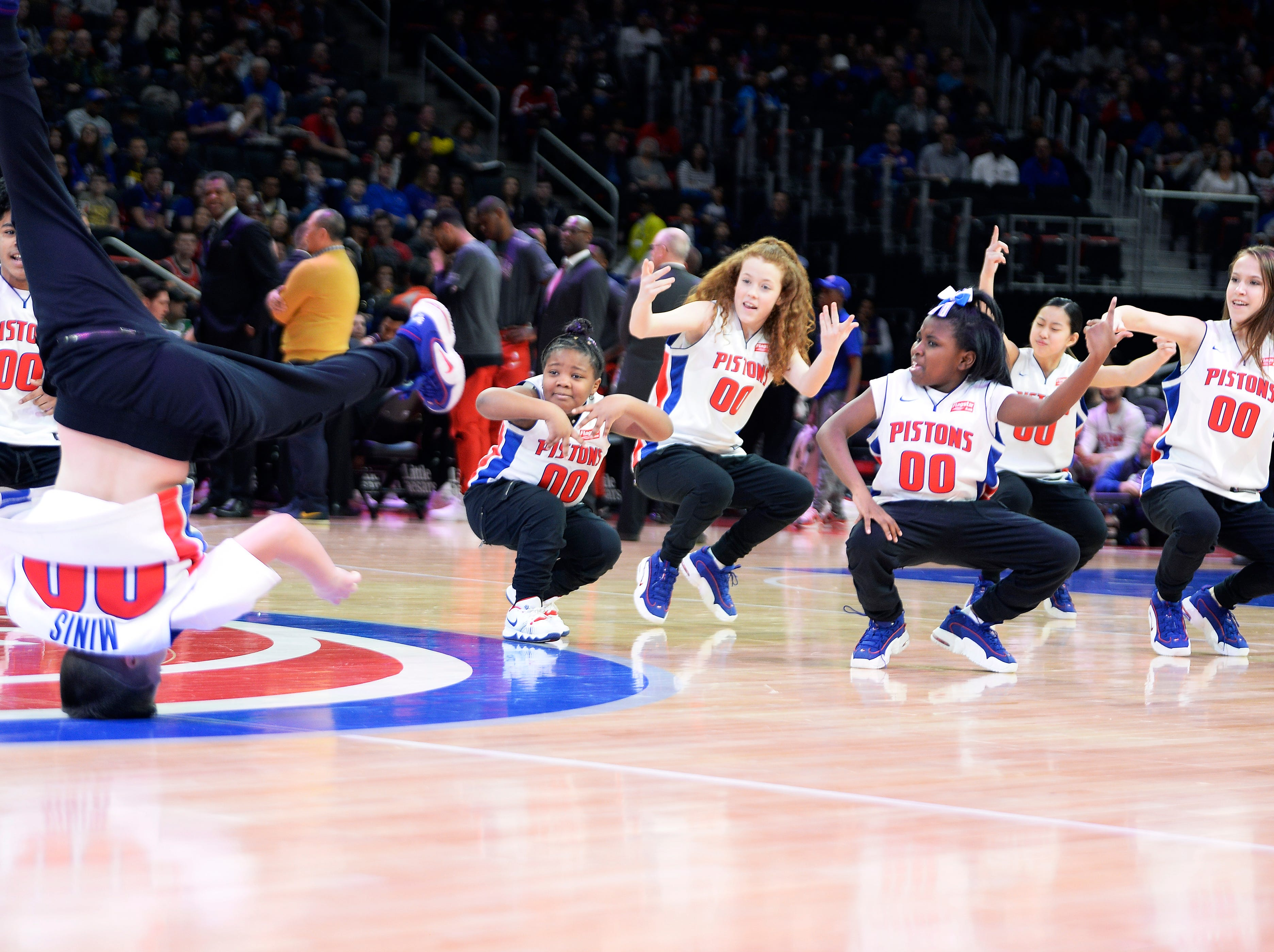 Pistons Minis Dancers perform in the second quarter on Kid's Day.