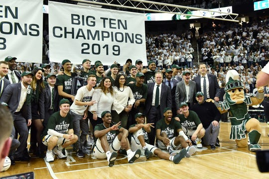 The Michigan State team with the Big Ten Championship 2019 banner after the game.