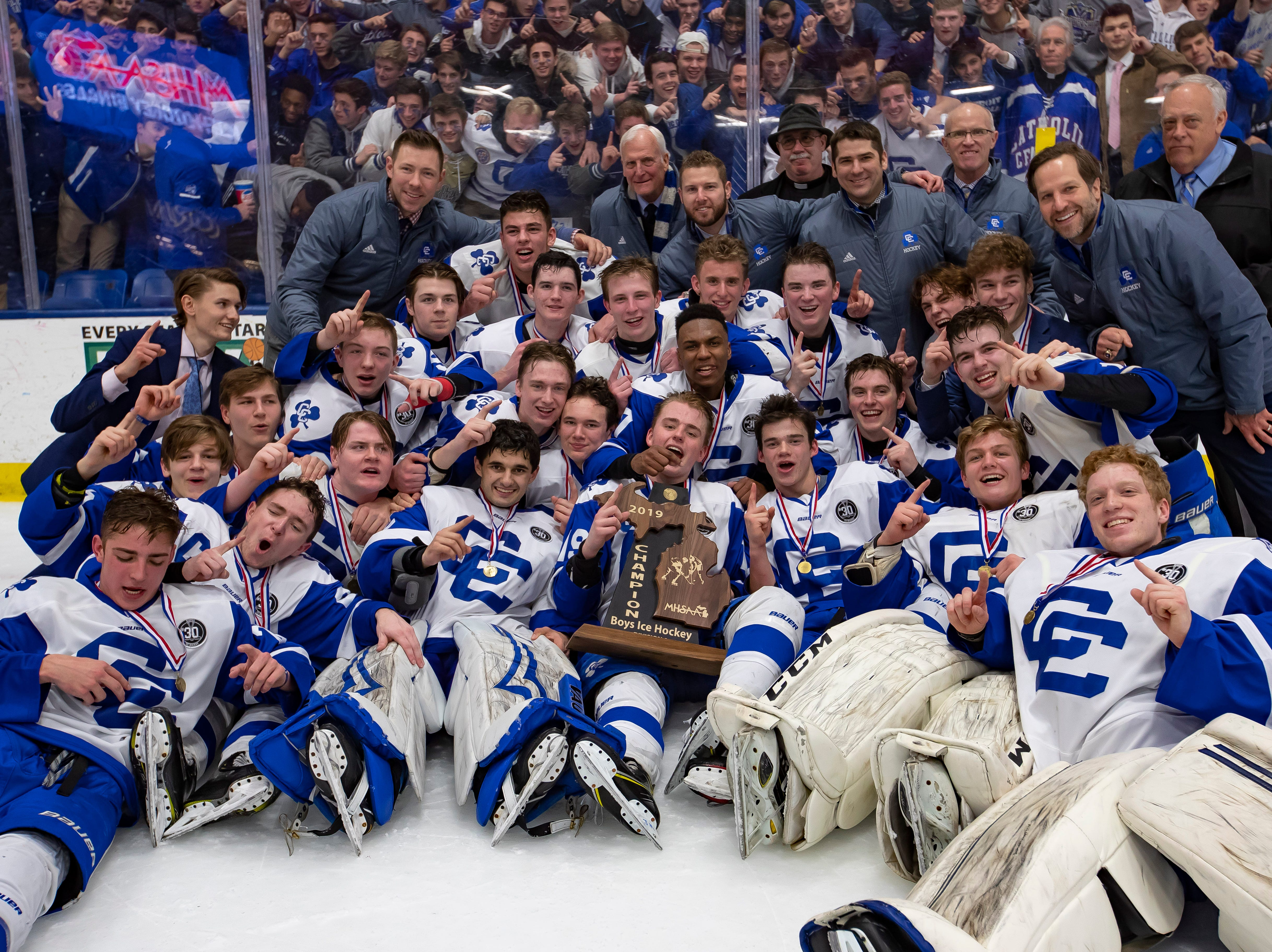Catholic Central's hockey team poses for a team picture after defeating Saginaw Heritage 3-1 to win the MHSAA Division 1 Championship at USA Arena in Plymouth on March 9, 2019.