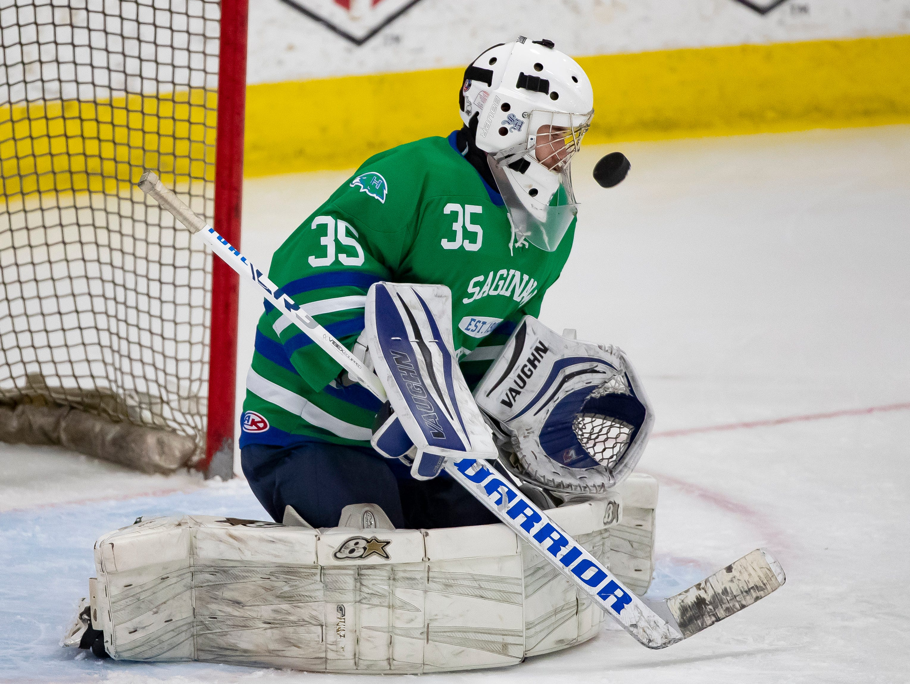 Goalie Jacob Winters of Saginaw Heritage takes some shots in warmups prior to  playing Detroit Catholic Central in the MHSAA Division 1 Finals.