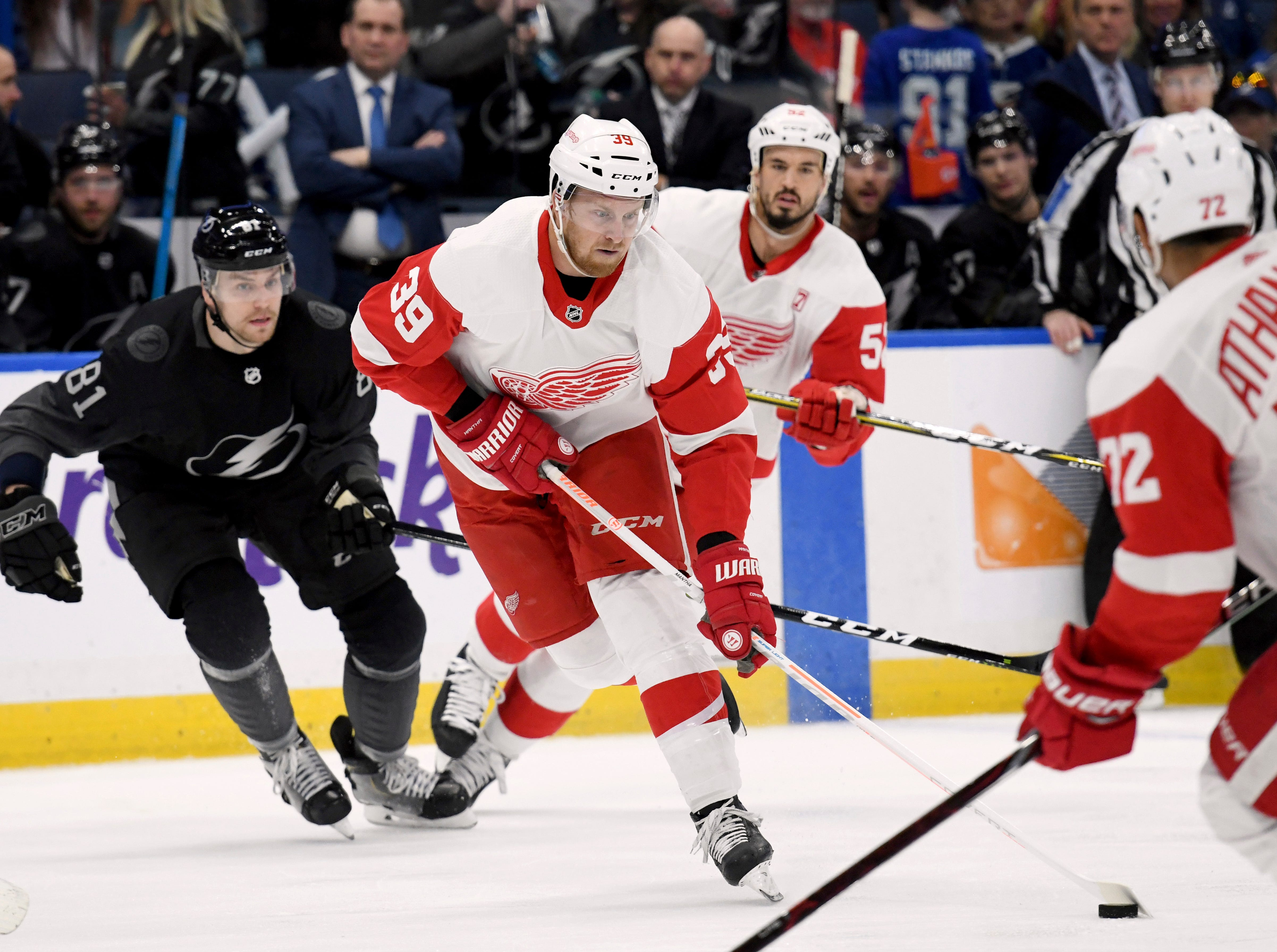 Detroit Red Wings right wing Anthony Mantha (39) handles the puck during the first period of an NHL hockey game against the Tampa Bay Lightning Saturday, March 9, 2019, in Tampa, Fla. (AP Photo/Jason Behnken)