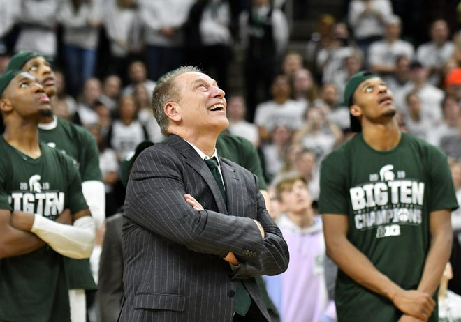 Michigan State coach Tom Izzo watches video highlights of senior players after the win over Michigan.