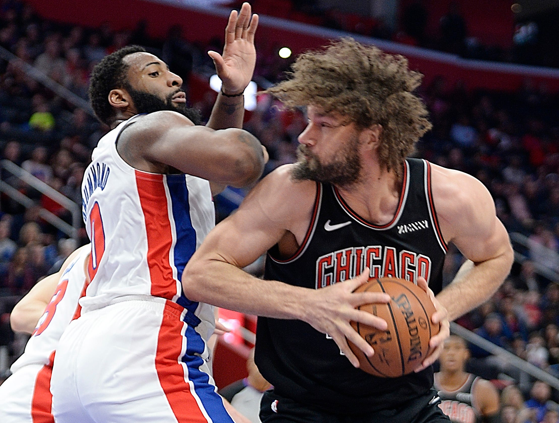 Bulls' Robin Lopez looks for room around Pistons' Andre Drummond in the first quarter.