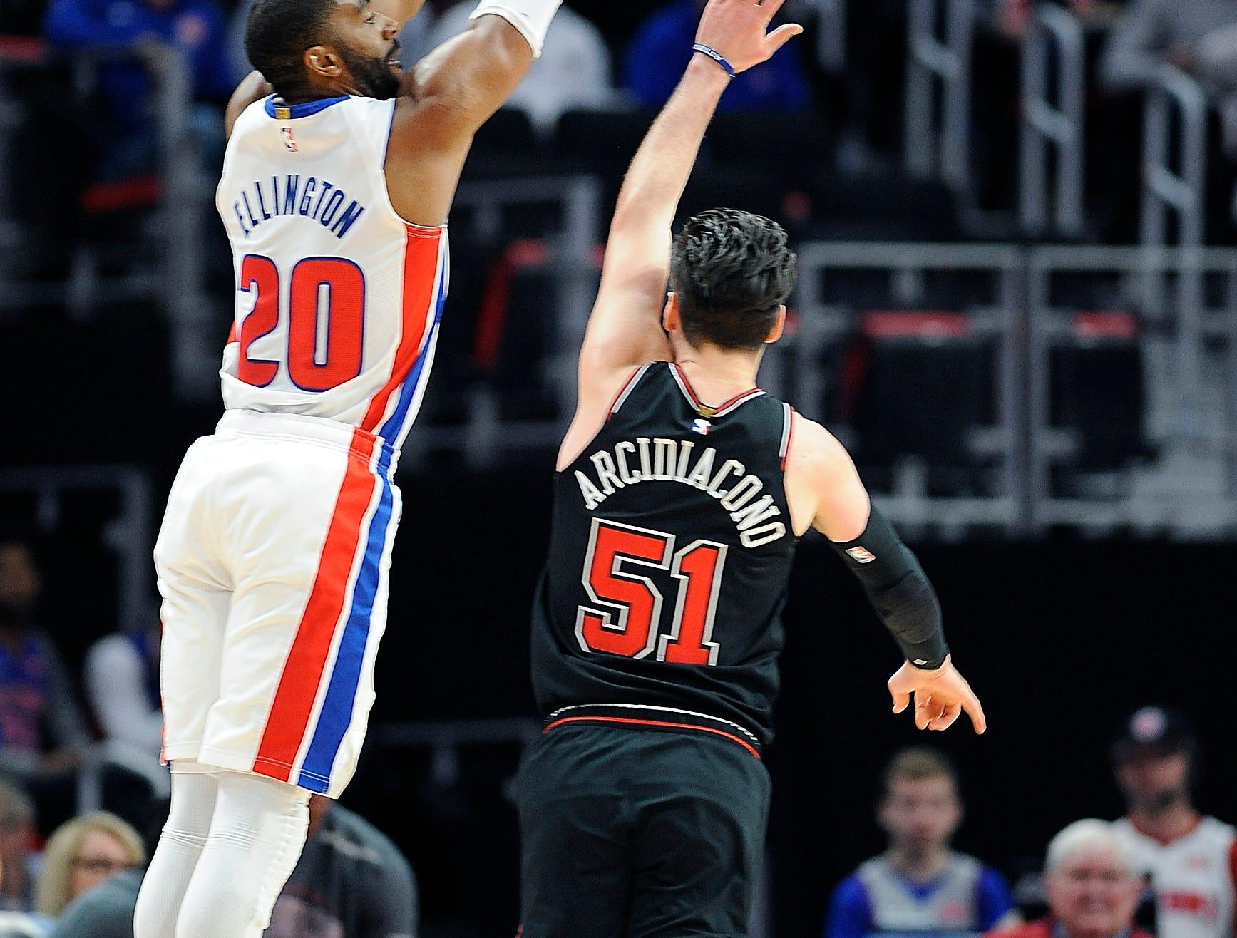 Pistons' Wayne Ellington scores over Bulls' Ryan Arcidiacono in the first quarter.