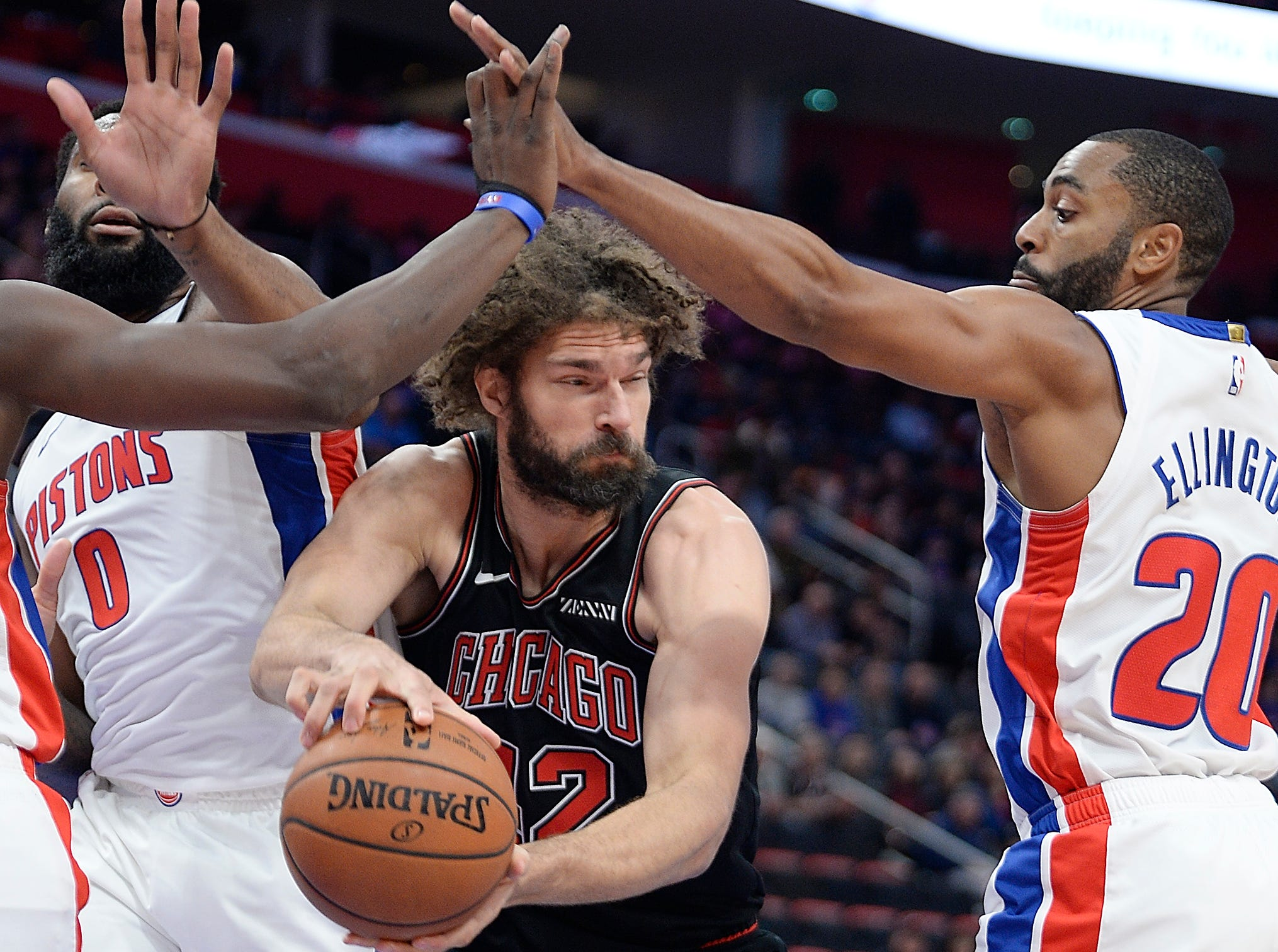 l-r, Pistons' Andre Drummond and Wayne Ellington defends the Bulls' Robin Lopez in the second quarter.