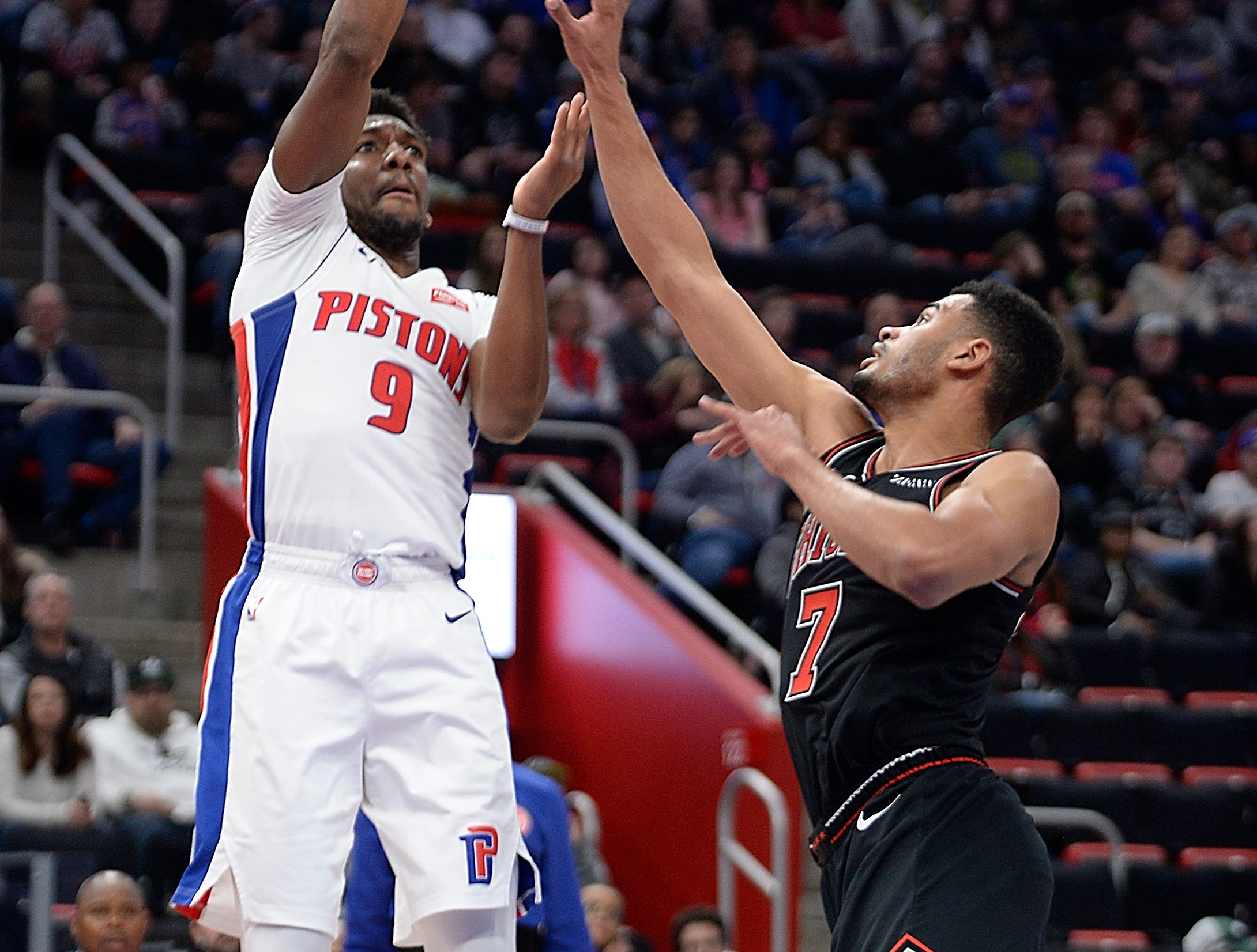 Pistons' Langston Galloway scores over Bulls' Timothe Luwawu-Cabarrot in the fourth quarter. Galloway had 21 points on 6-6 shooting on 3-point baskets. The Pistons defeated the Bulls 131-108, Sunday, March 10, 2019 at Little Caesars Arena in Detroit, Michigan.