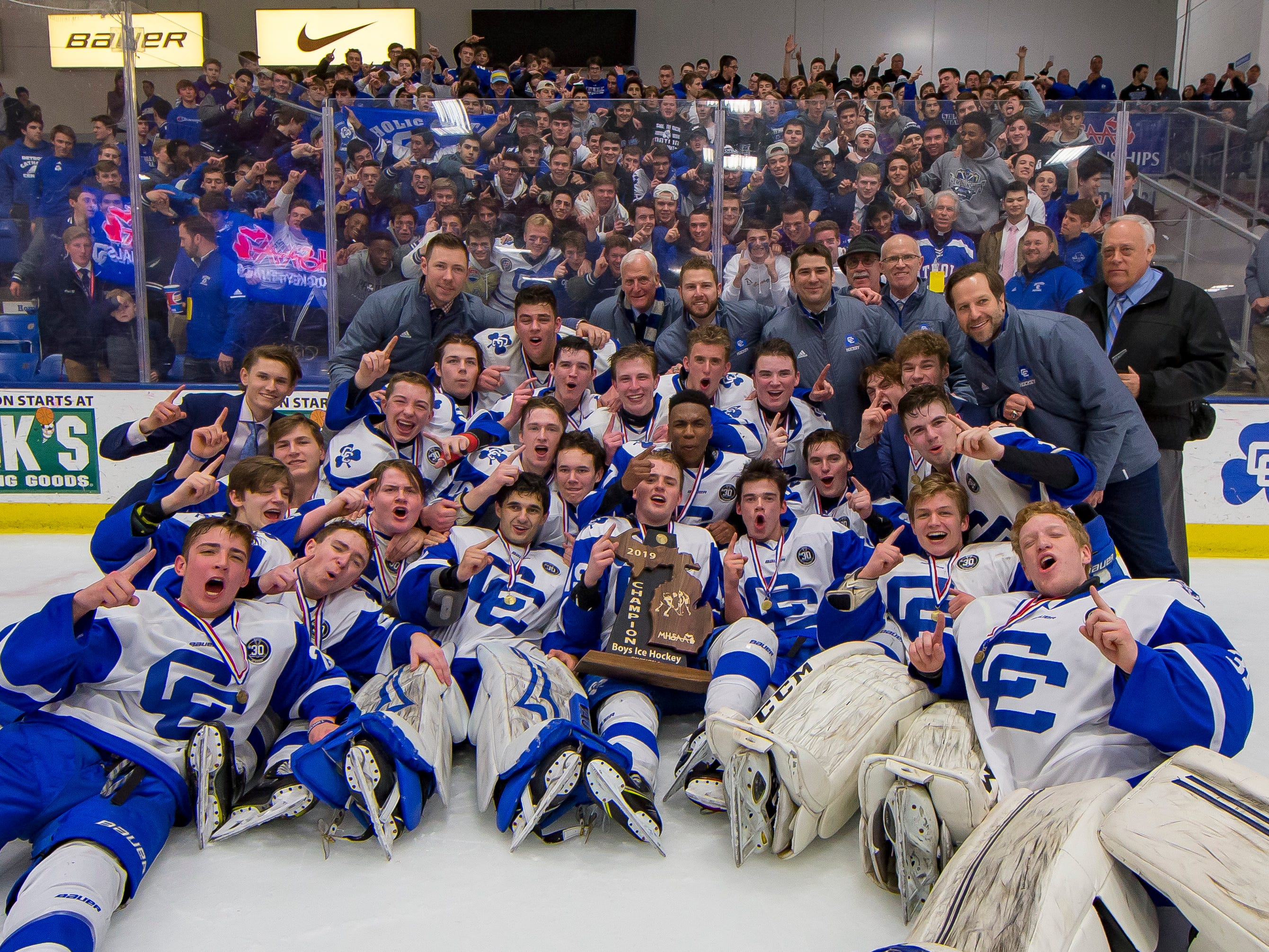 The Catholic Central team poses for a team picture after defeating Saginaw Heritage 3-1 to win the MHSAA Division 1 Championship at USA Arena in Plymouthy on March 9, 2019.