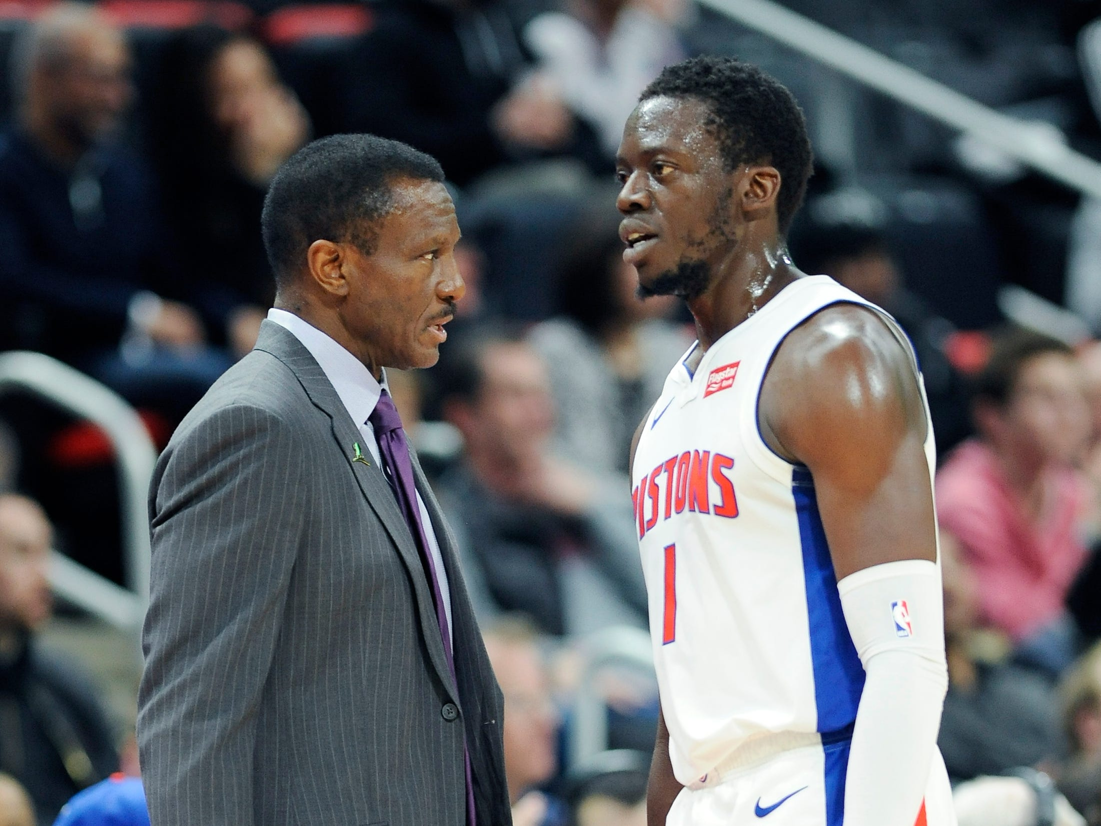 Pistons head coach Dwane Casey and Reggie Jackson talk in the second.