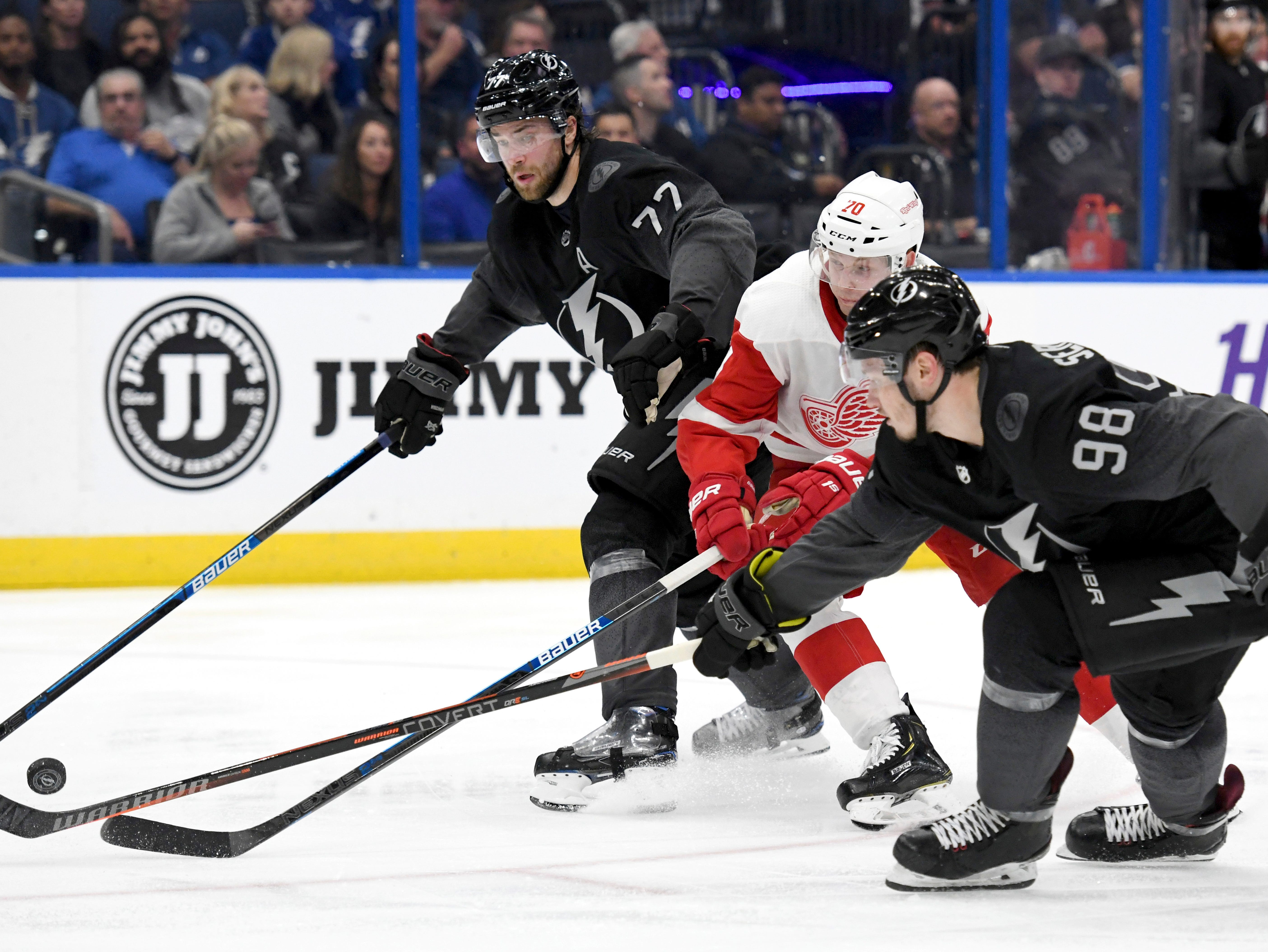 Tampa Bay Lightning defenseman Victor Hedman (77) and defenseman Mikhail Sergachev (98) defend against Detroit Red Wings center Christoffer Ehn (70) during the third period of an NHL hockey game Saturday, March 9, 2019, in Tampa, Fla. (AP Photo/Jason Behnken)