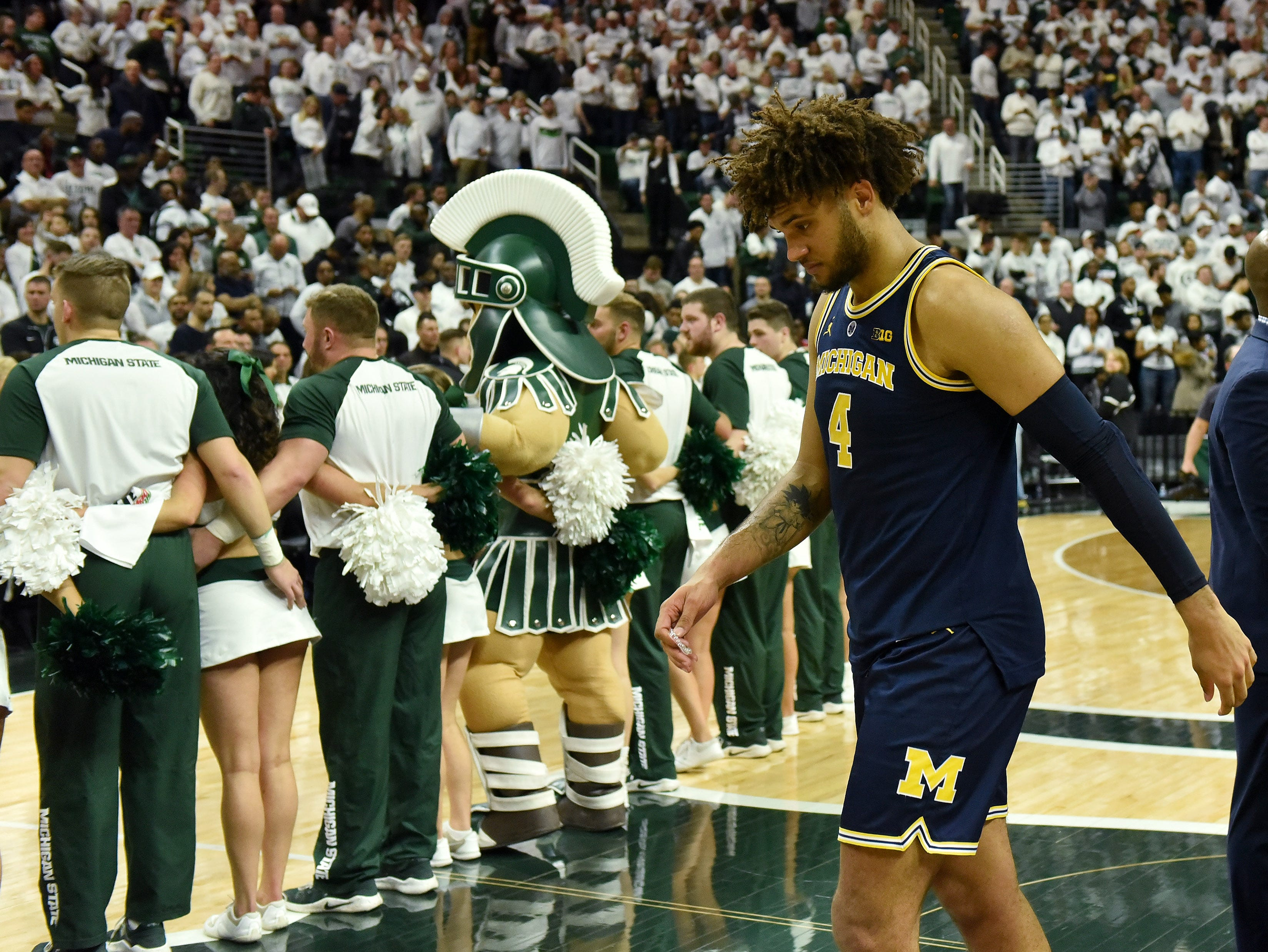 Michigan forward Isaiah Livers (4) walks off the floor after the game.   Michigan vs Michigan State at the Breslin Center in East Lansing, Mich. on Mar. 9, 2019.  Michigan State wins, 75-63.(Robin Buckson / Detroit News)