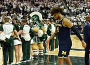 Michigan forward Isaiah Livers (4) walks off the floor after the game.   Michigan vs Michigan State at the Breslin Center in East Lansing, Mich. on Mar. 9, 2019.  Michigan State wins, 75-63.
