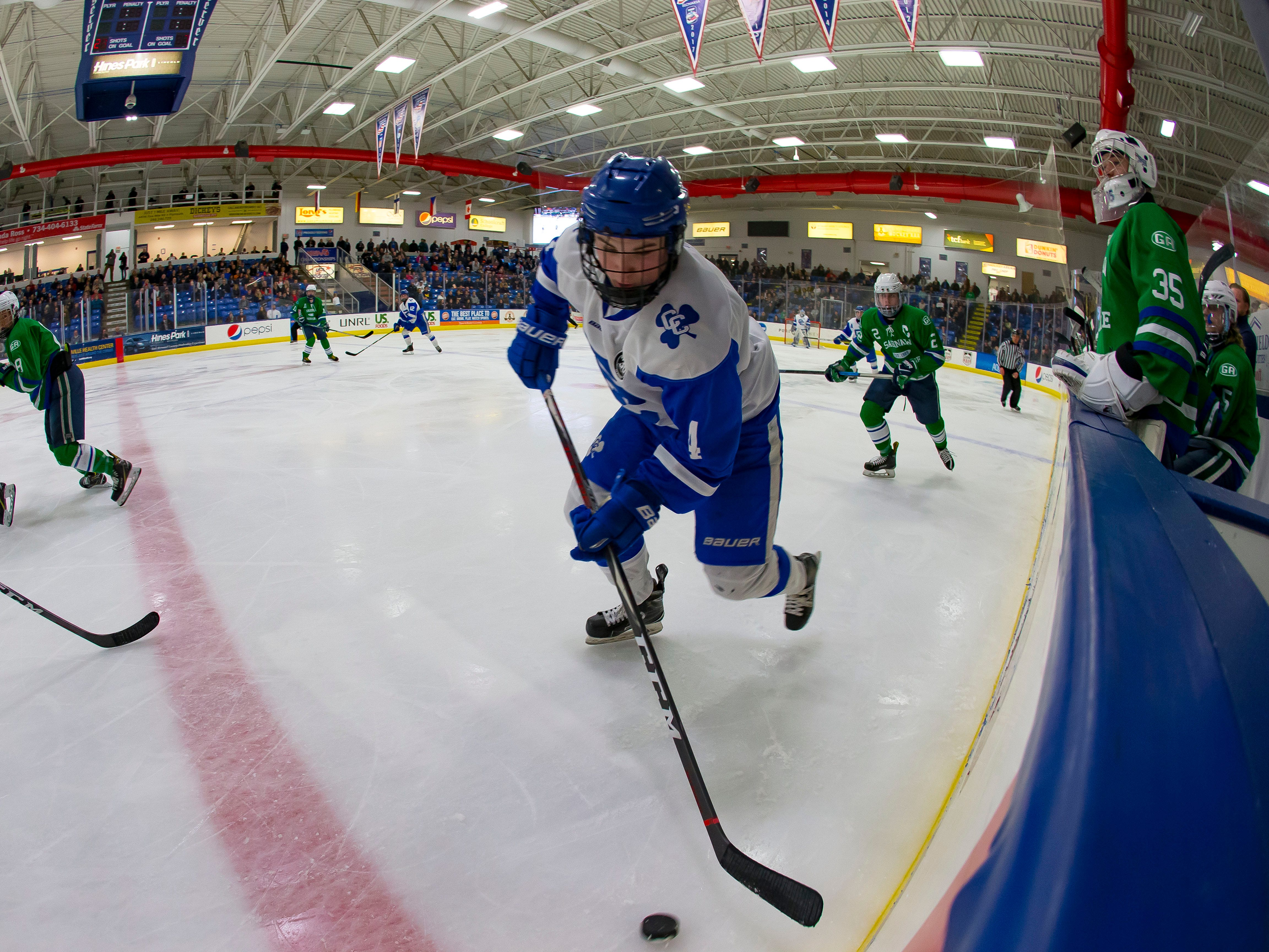 Justin Roe (4) of Catholic Central skates up ice with the puck against Saginaw Heritage during the second period.