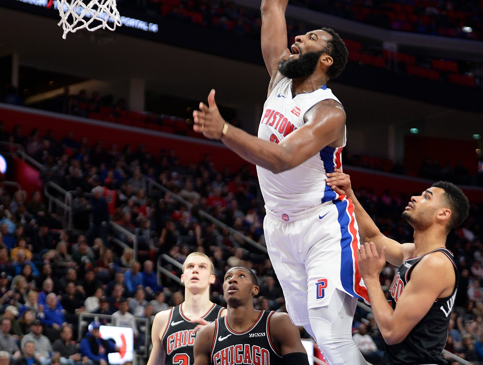 Pistons' Andre Drummond dunks over Bulls' l-r, Kris Dunn and Timothe Luwawu-Cabarrot in the third quarter. Drummond had 16 points and 15 rebounds.