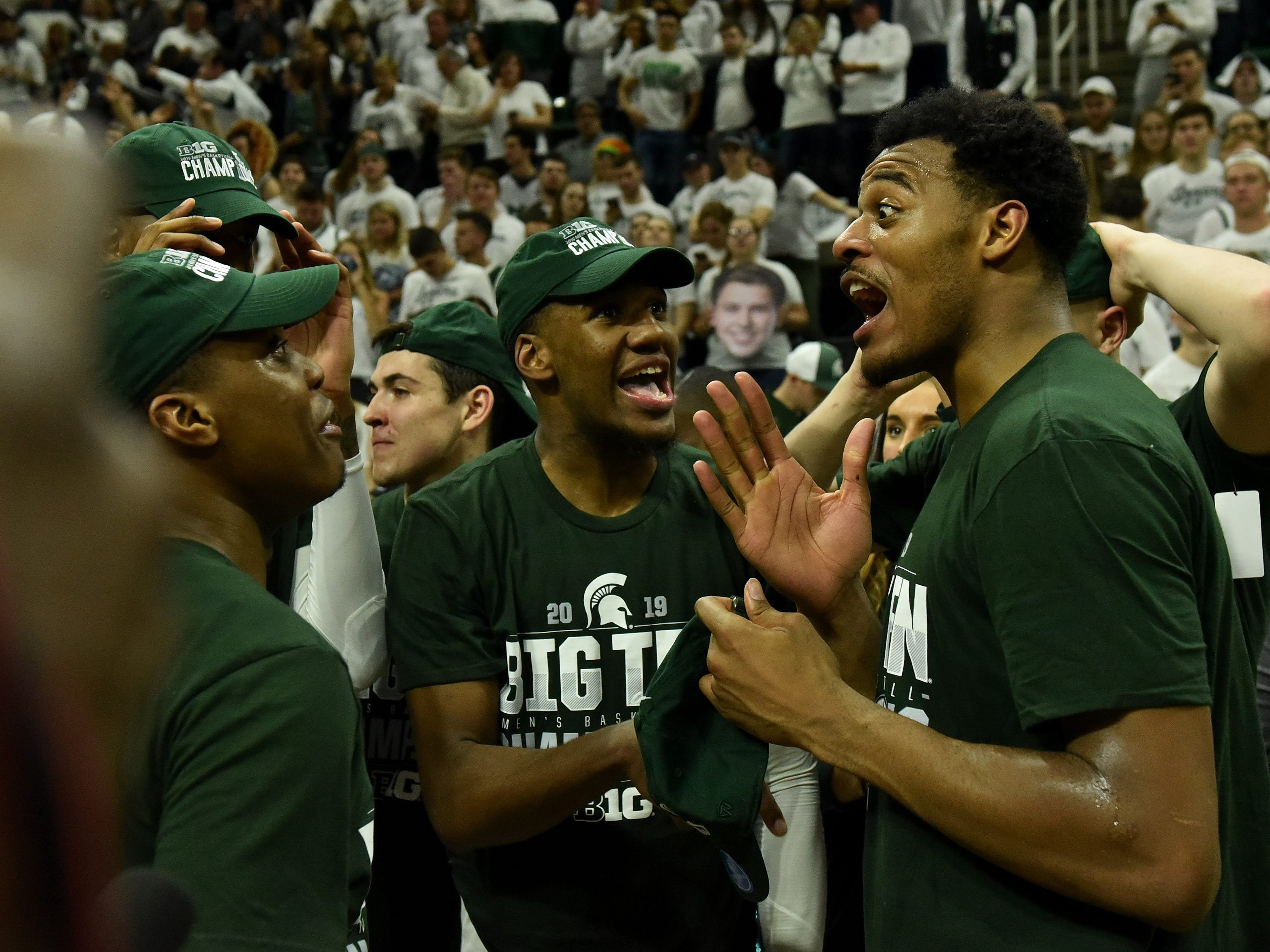Michigan State teammates from right, Xavier Tillman, Aaron Henry and Cassius Winston celebrate after the game.