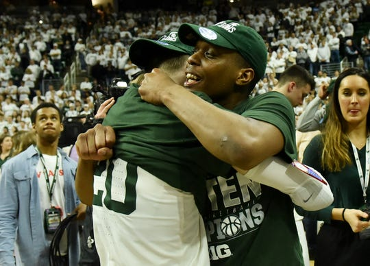 Michigan State guard Cassius Winston hugs Michigan State guard Matt McQuaid after the win over Michigan.