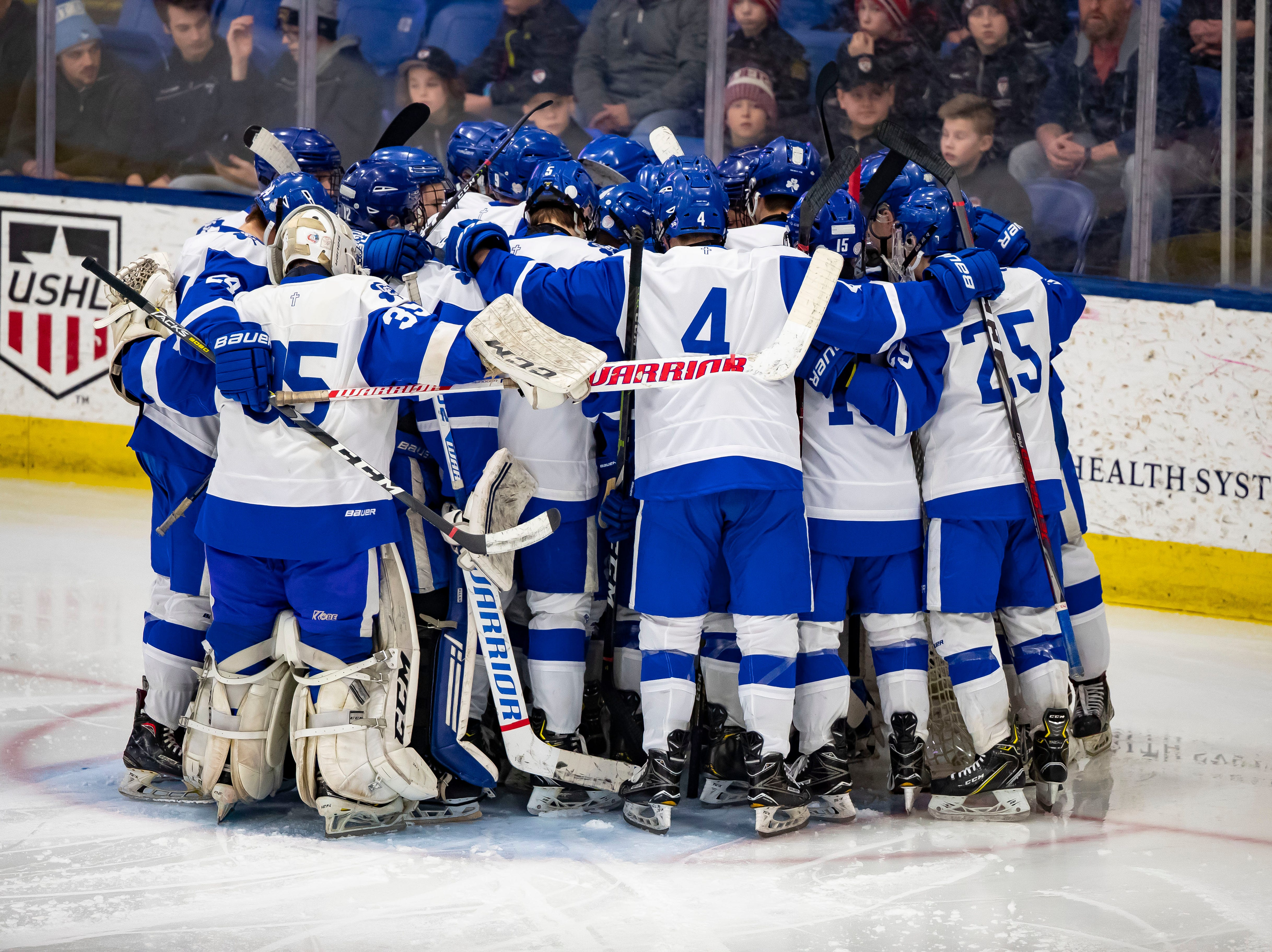 The Catholic Central players gather around the net before the start of the MHSAA Division 1 Finals.