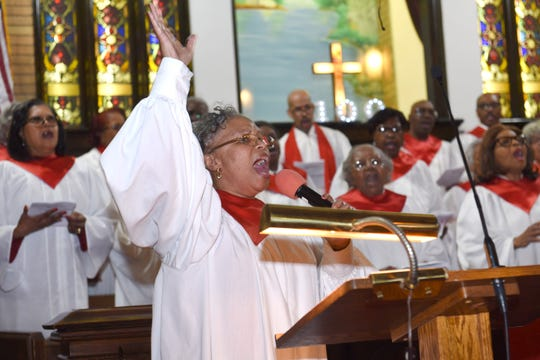 Sister Felicia Kemp leads the centennial celebration song with the Dexter Mass Choir as the congregation takes part in the 100th anniversary of the Dexter Avenue Baptist Church on Thursday, March 7, 2019.