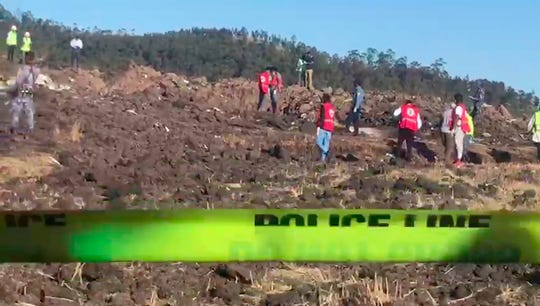 Rescuers search through wreckage after an Ethiopian Airlines flight crashed shortly after takeoff at Hejere, Ethiopia Sunday, March 10, 2019.