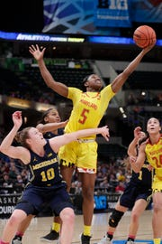 Maryland guard Kaila Charles (5) grabs a rebound over Michigan guard Nicole Munger (10) in the second half of an NCAA college basketball semifinal game at the Big Ten Conference tournament in Indianapolis, Saturday, March 9, 2019. Maryland defeated Michigan 73-72. (AP Photo/Michael Conroy)