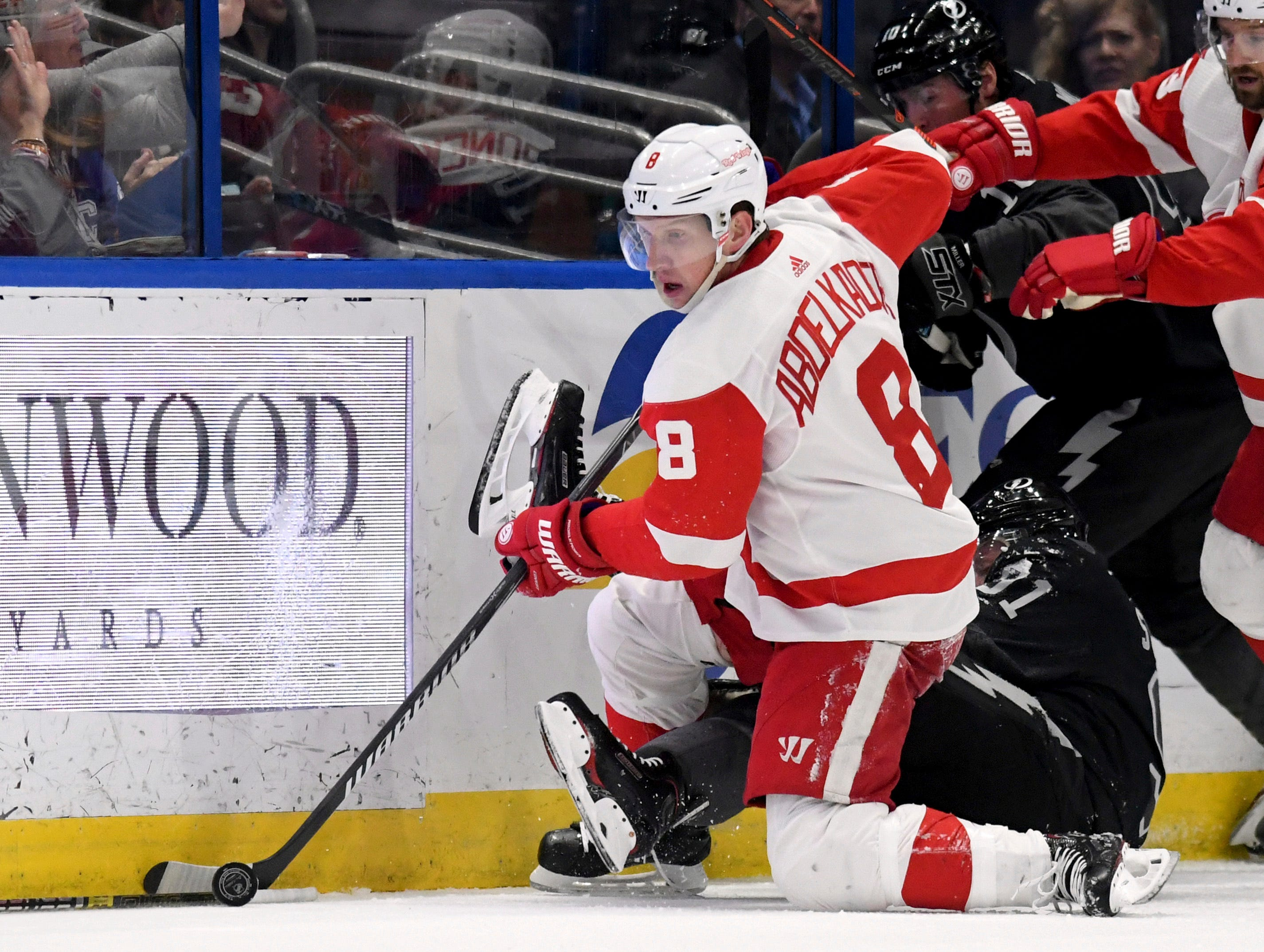 Detroit Red Wings left wing Justin Abdelkader (8) handles the puck along the boards during the first period of an NHL hockey game against the Tampa Bay Lightning Saturday, March 9, 2019, in Tampa, Fla. (AP Photo/Jason Behnken)