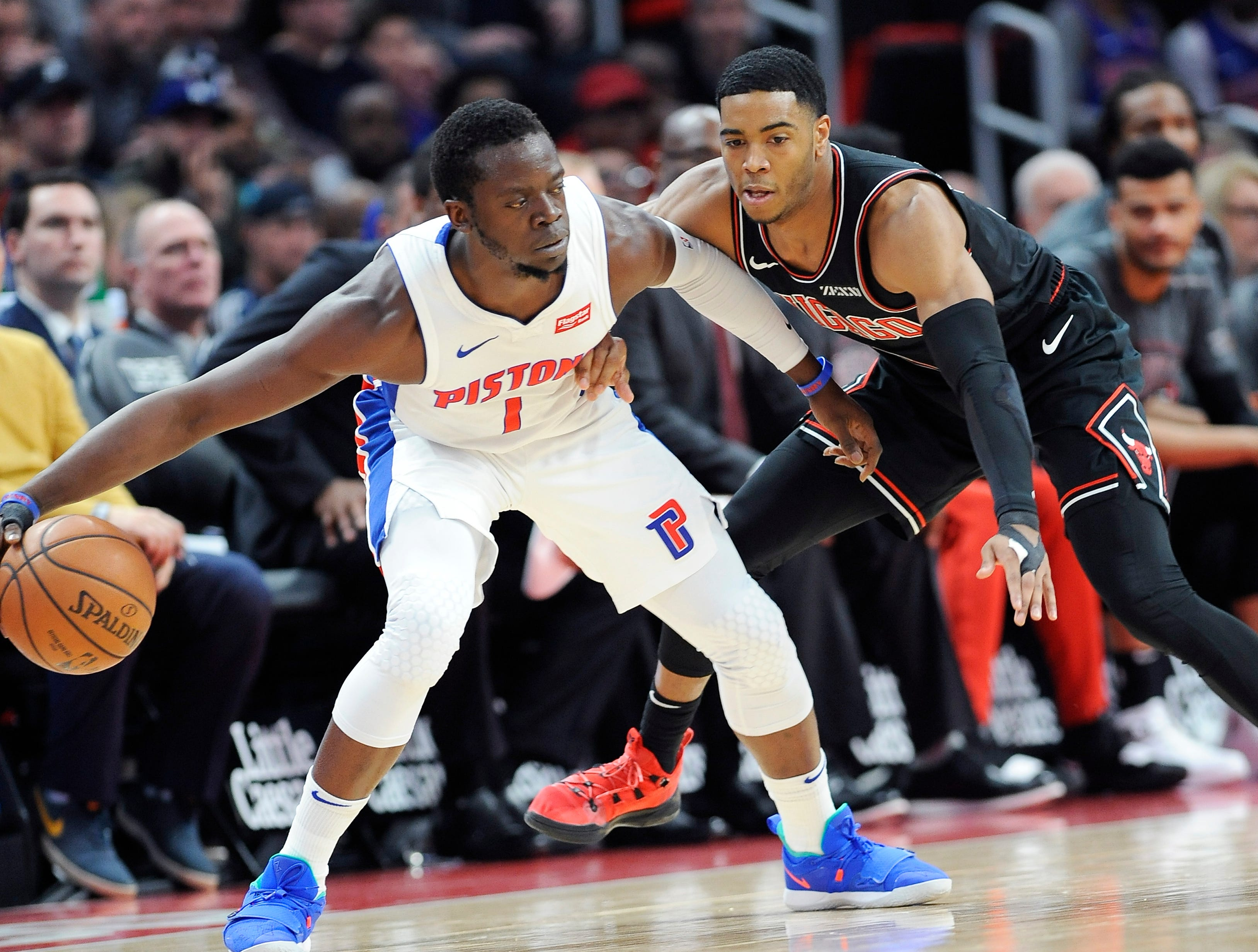 Pistons' Reggie Jackson looks for room around Bulls' Shaquille Harrison in the first quarter. Jackson had 21 points and 6 assists.
