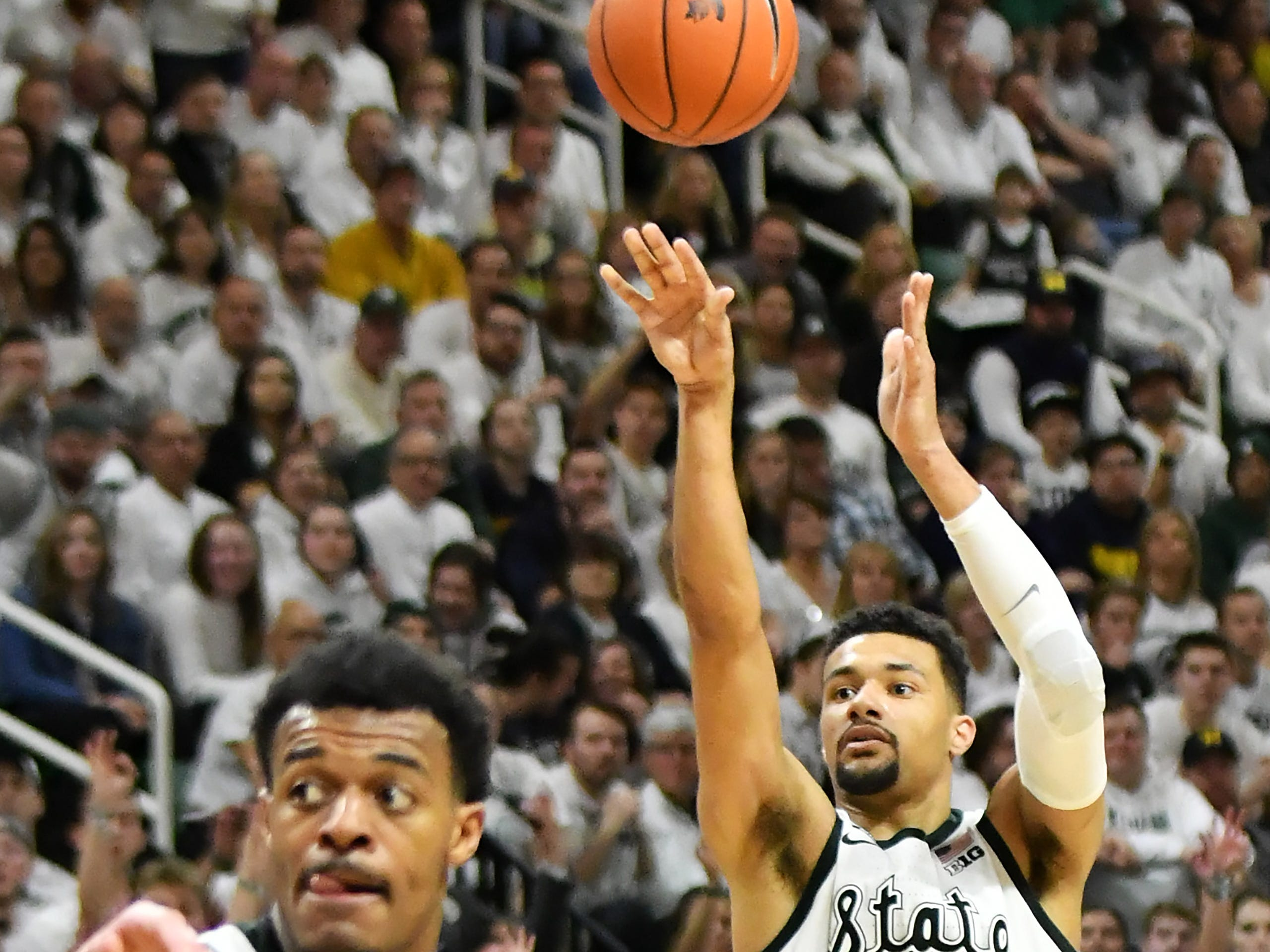 Michigan State forward Kenny Goins (25) hits a shot in the second half.