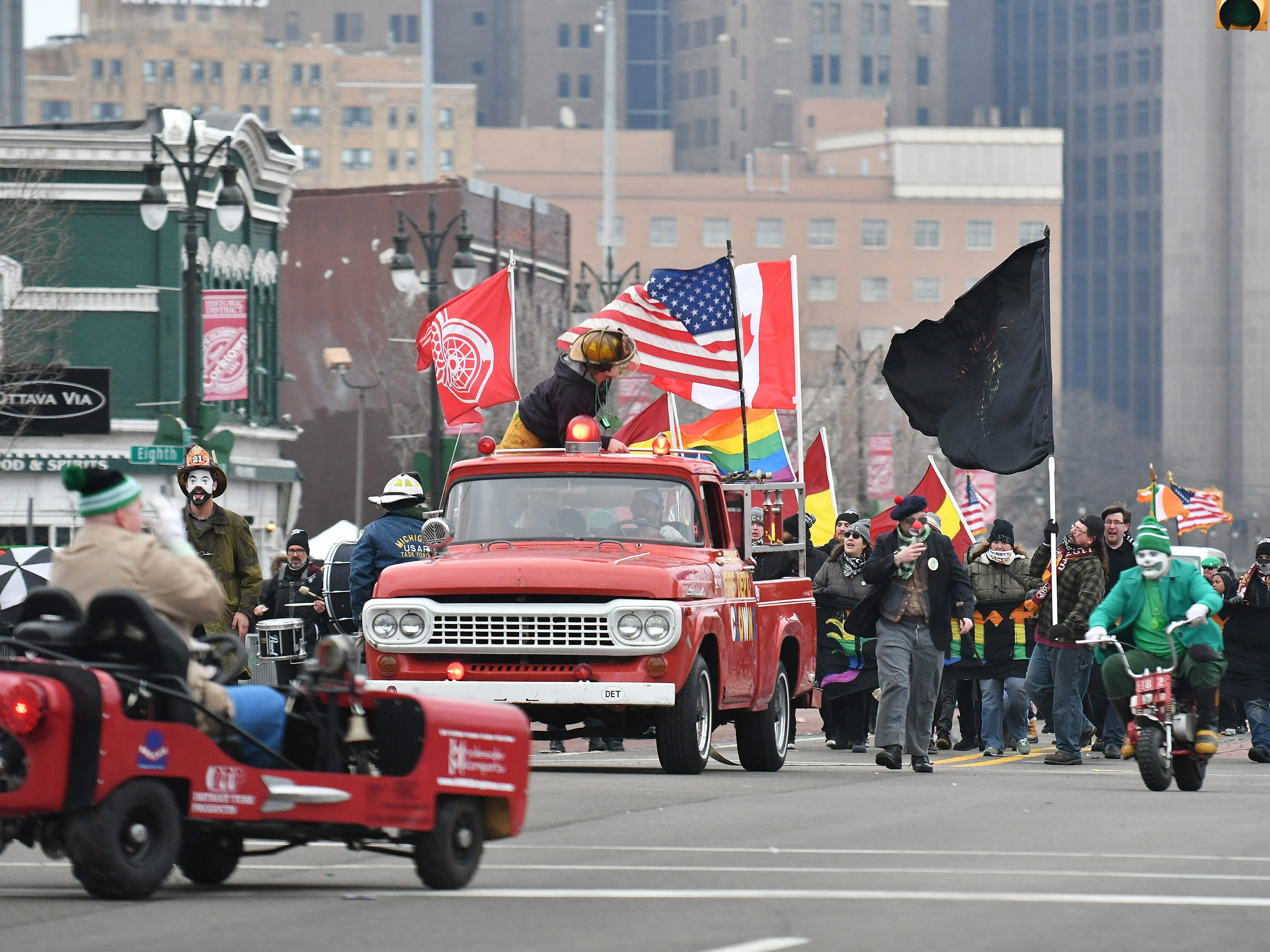 The Detroit Fire Department Clowns entertain in the 61st annual St. Patrick's Day Parade.