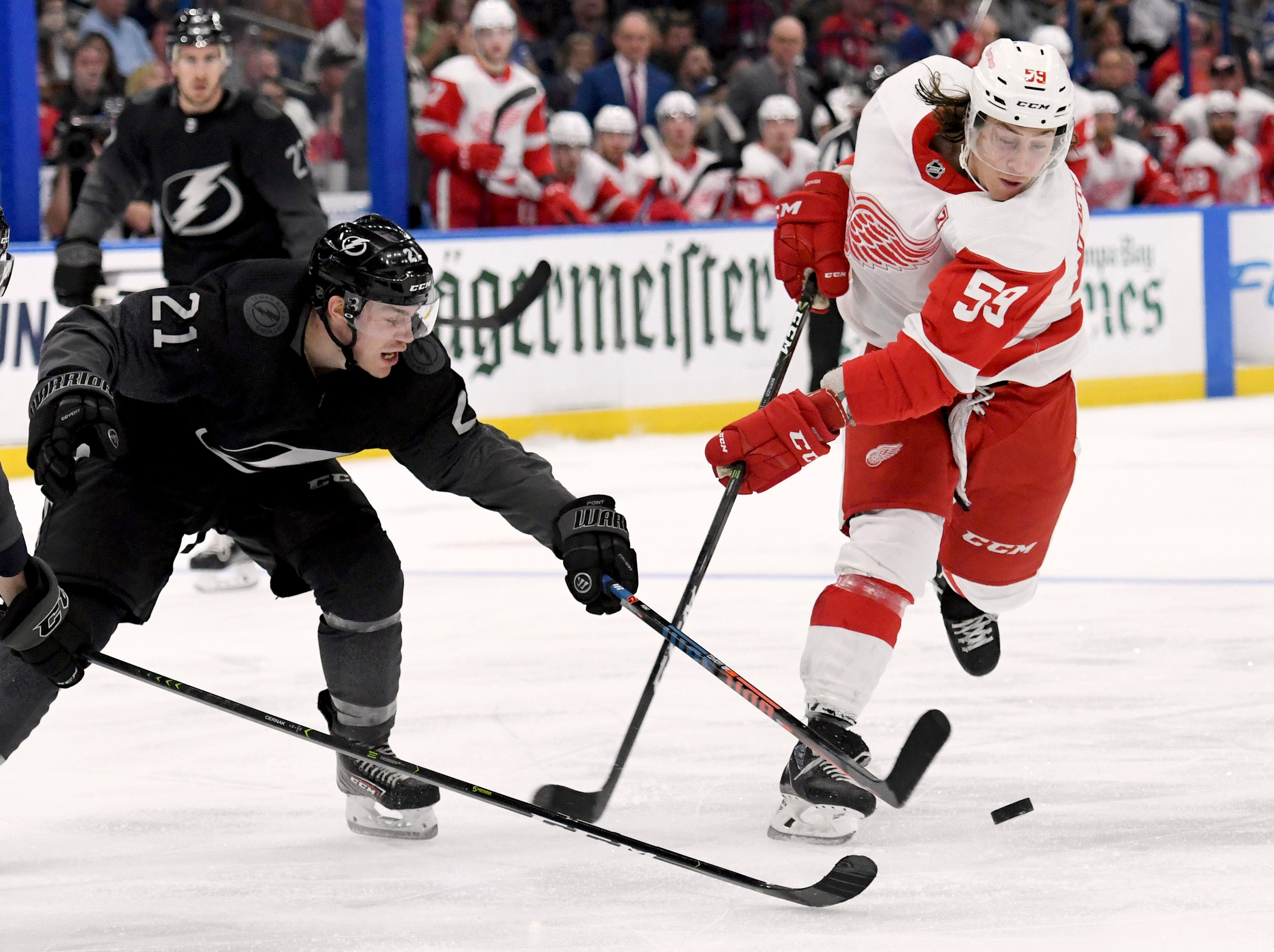 Tampa Bay Lightning center Brayden Point (21) blocks a shot by Detroit Red Wings left wing Tyler Bertuzzi (59) during the third period of an NHL hockey game Saturday, March 9, 2019, in Tampa, Fla. (AP Photo/Jason Behnken)