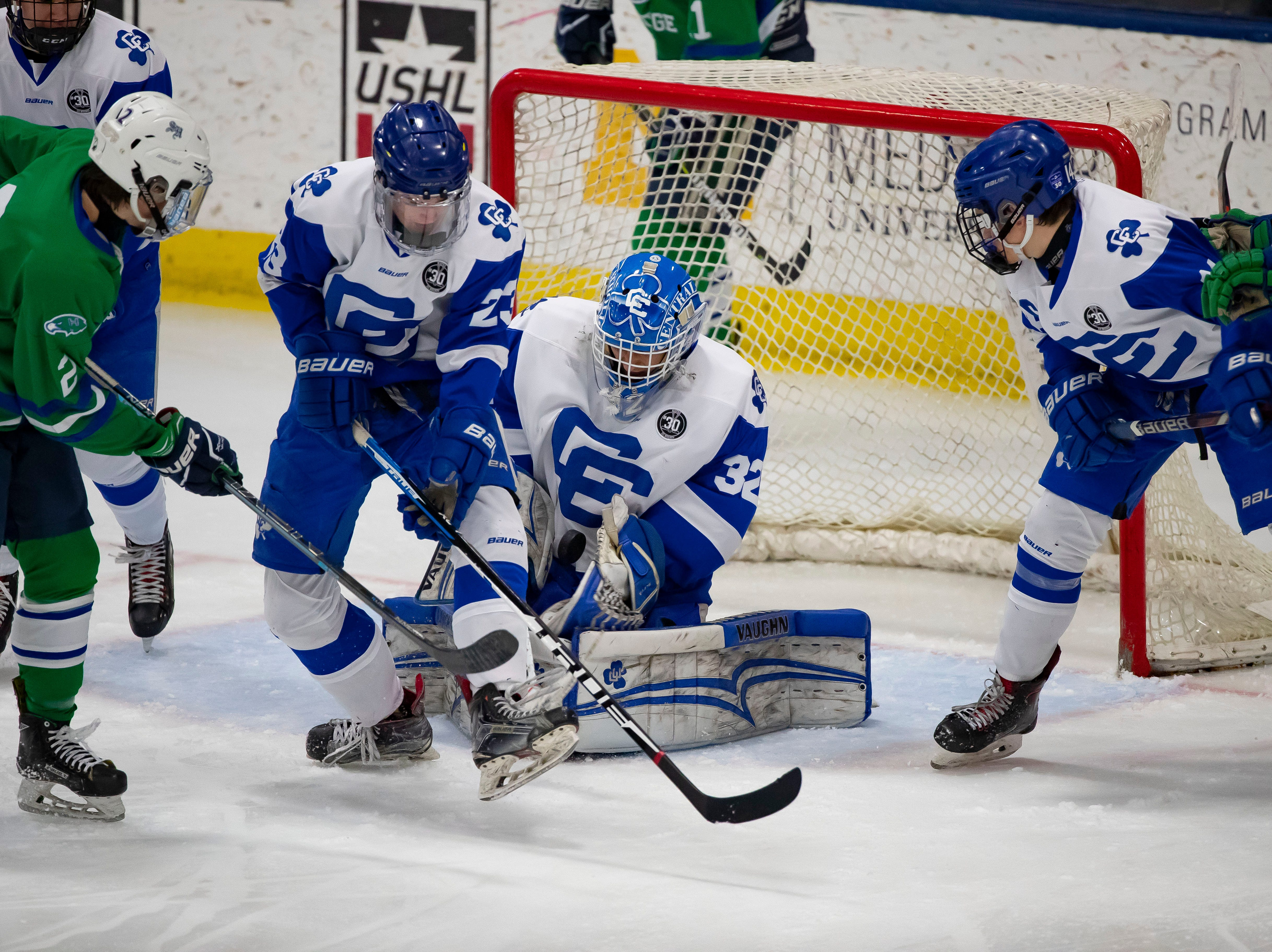 Goalie Stephen Steva (32) of Catholic Central makes a save in the first period against Saginaw Heritage.