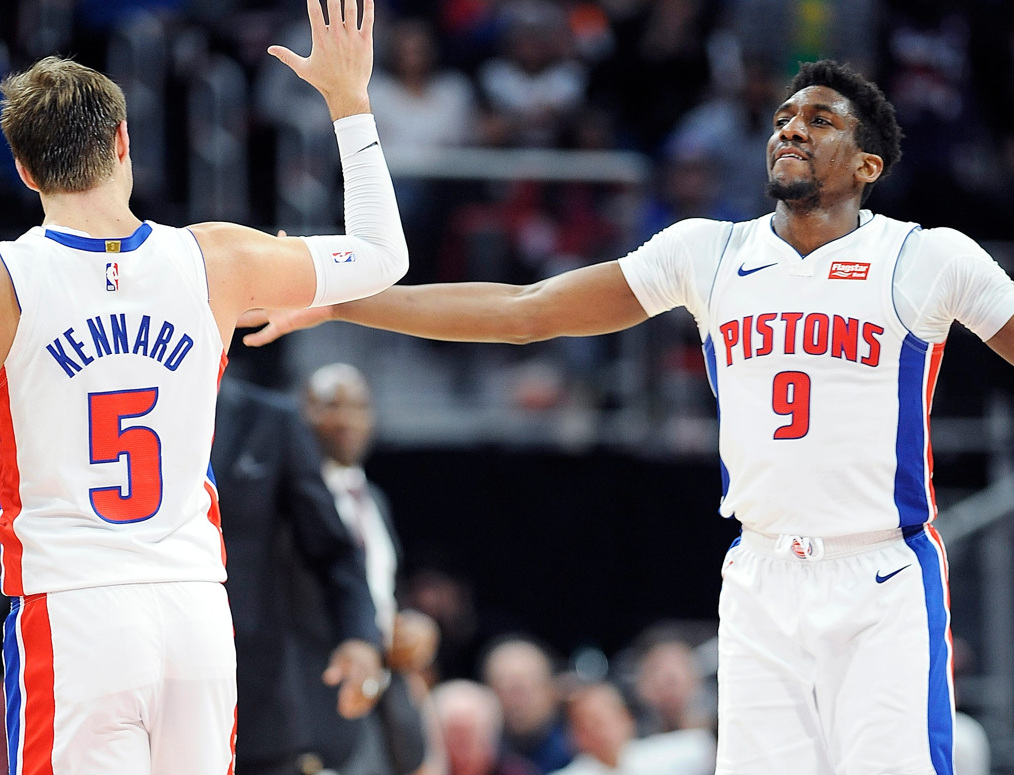 Pistons' Langston Galloway, (r), and Luke Kennard celebrate in the second quarter.