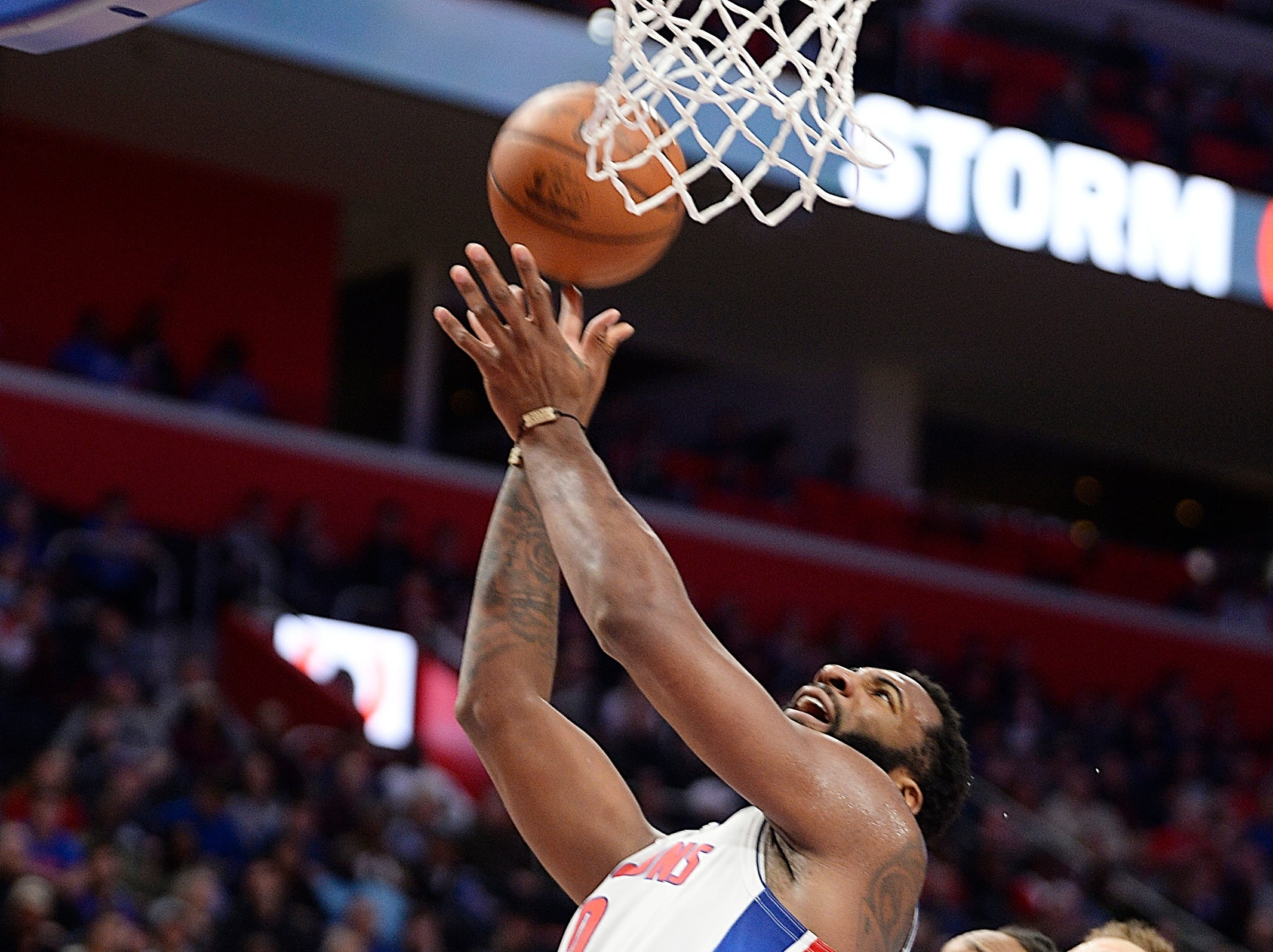 Pistons' Andre Drummond scores over Bulls' Wayne Selden Jr. in the third quarter.