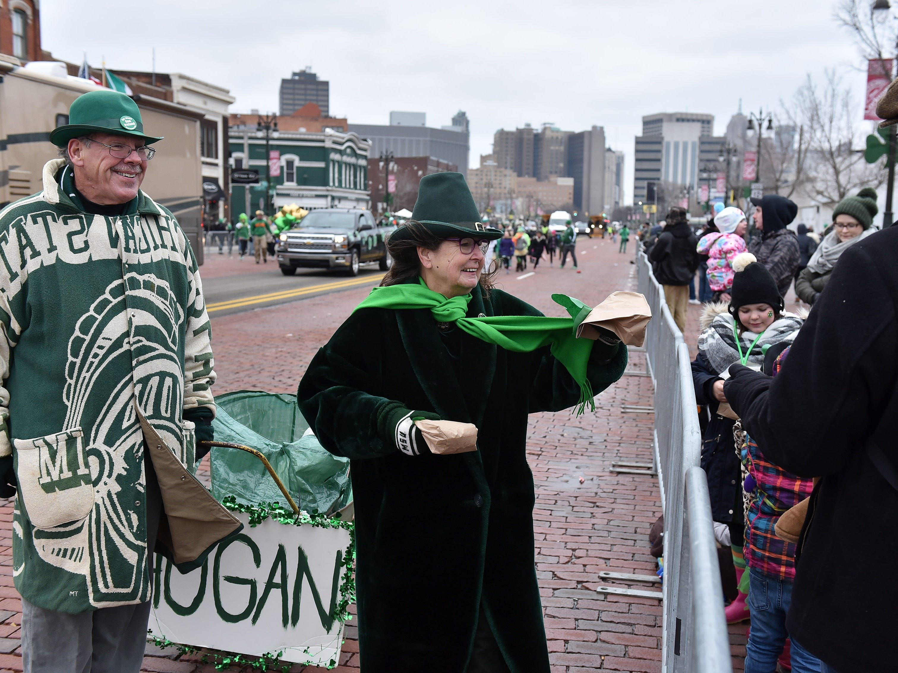 Michael and Maureen Hogan from the Gaelic League hand out bags with toys, candy and beads in them at the 61st annual St. Patrick's Day Parade.