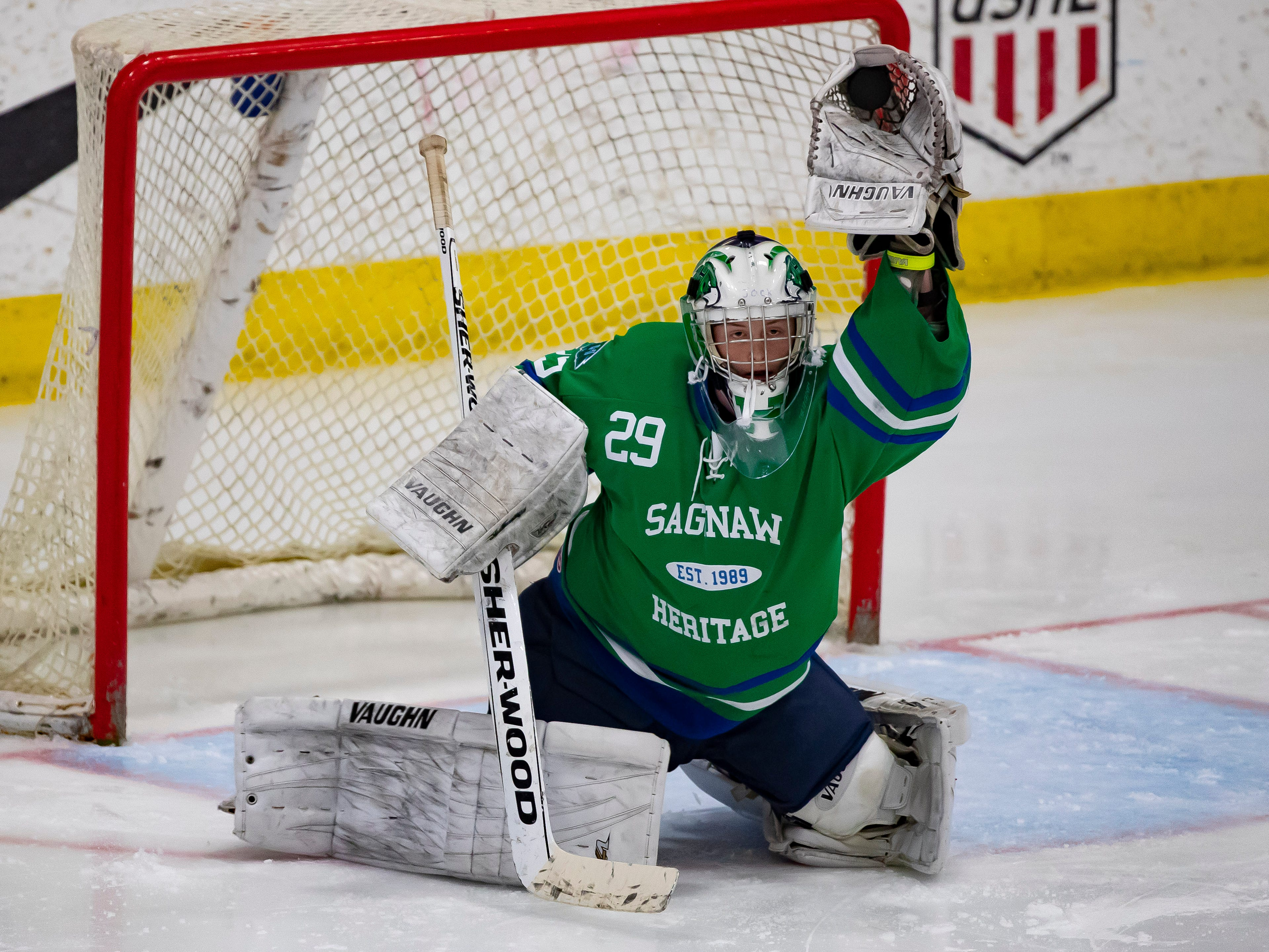 Jack Jesko (29) of Saginaw Heritage makes a glove save in the first period against Catholic Central.