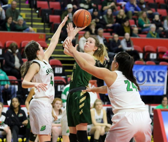 Kaitlyn McCabe of Roosevelt puts up a shot as Seton Catholic Central's Bridget Martin (4) and Marina Maerkl (24) defend during a girls Class A regional game Sunday at the Floyd L. Maines Veterans Memorial Arena in Binghamton.