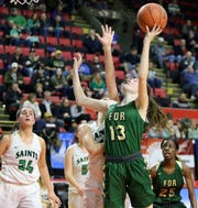 Kamryn Hammond of Roosevelt goes up for a shot against Binghamton Seton Catholic Central during a girls Class A regional game March 10, 2019 at the Floyd L. Maines Veterans Memorial Arena in Binghamton.