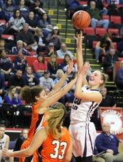 Adrienna Solomon of Watkins Glen puts up a shot against Cooperstown in a girls Class C regional final Sunday at Floyd L. Maines Veterans Memorial Arena in Binghamton.