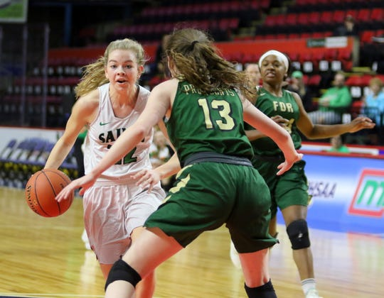 Reese Vaughn of Binghamton Seton Catholic Central drives toward the basket as Roosevelt's Kamryn Hammond defends during a girls Class A regional game March 10, 2019 at the Floyd L. Maines Veterans Memorial Arena in Binghamton.