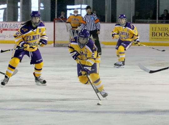 Maddie Evangelous of Elmira Collebe brings the puck up the ice during an NCAA Division III women's hockey quarterfinal against Adrian on March 9, 2019 at the Murray Athletic Center in Pine Valley