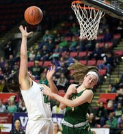 Marina Maerkl of Binghamton Seton Catholic Central goes up for two points as Kelsea Demelis of Roosevelt defends during a girls Class A regional game March 10, 2019 at the Floyd L. Maines Veterans Memorial Arena in Binghamton.