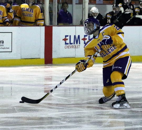 Meg Lahey of Elmira College takes a shot during an NCAA Division III women's hockey quarterfinal against Adrian on March 9, 2019 at the Murray Athletic Center in Pine Valley
