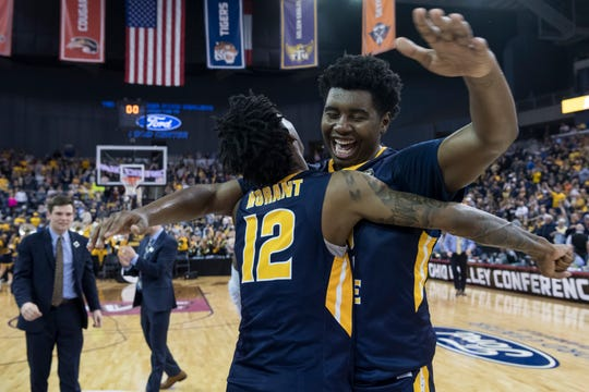 Murray State's Ja Morant (12) and Murray State's Darnell Cowart (32) embrace following their Ohio Valley Conference championship win over the Belmont University Bruins at Ford Center in Evansville, Ind., Saturday, March 9, 2019. The Racers earned the OVC men's championship title after defeating the Bruins, 77-65.