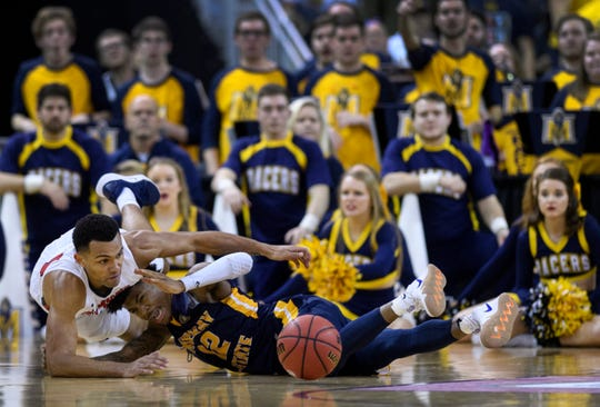 Belmont's Michael Benkert (24) Murray State's Ja Morant (12) fight for a loose ball during the second half of the Ohio Valley Conference men's basketball championship at Ford Center in Evansville, Ind., Saturday, March 9, 2019. The Racers earned the OVC men's championship title after defeating the Bruins, 77-65.