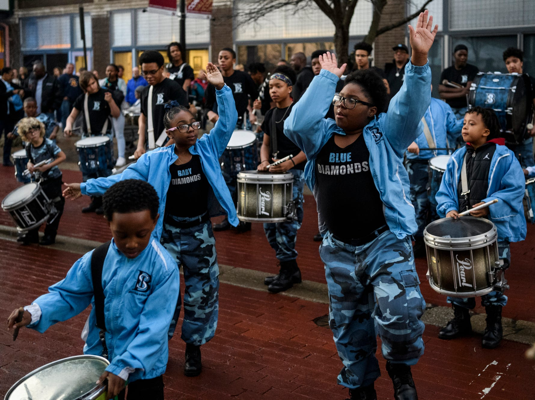 Jay'mon Hale, front left, Micah Smith, back left, and Bri'Airah Bryant, right, perform with the Boom Squad on Main Street in downtown Evansville as people wait to get into the Ford Center for the Ohio Valley Conference men's championship game, Saturday, March 9, 2019.