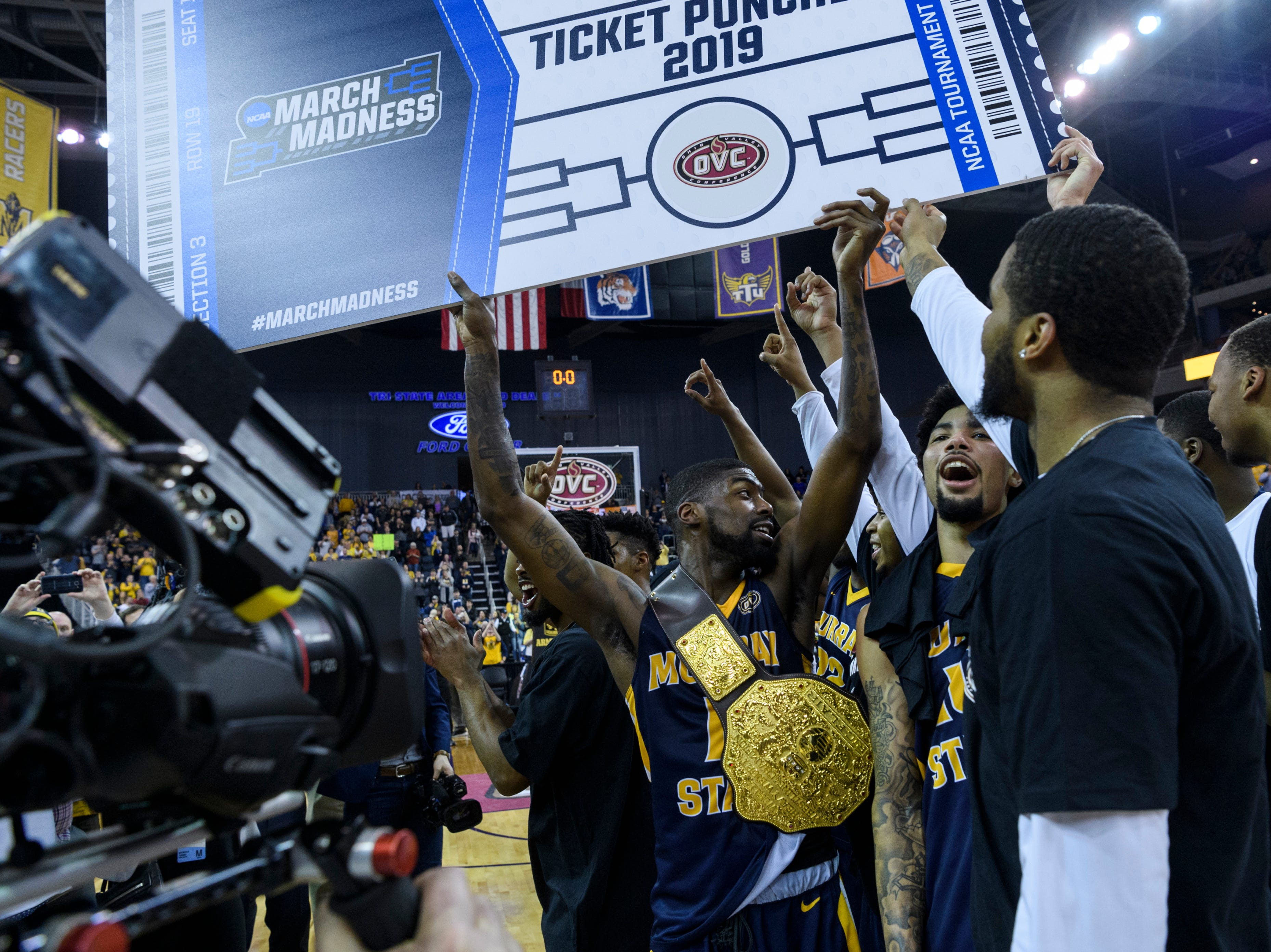 The Murray State University Racers celebrate their automatic bid to the NCAA tournament following their Ohio Valley Conference championship win at Ford Center in Evansville, Ind., Saturday, March 9, 2019. The Racers earned the OVC men's championship title after defeating the Bruins, 77-65.