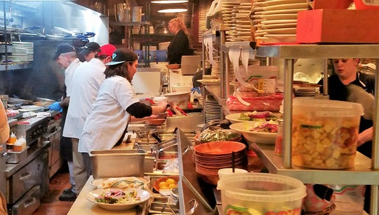 The busy open kitchen at Smitty's Italian Steakhouse.