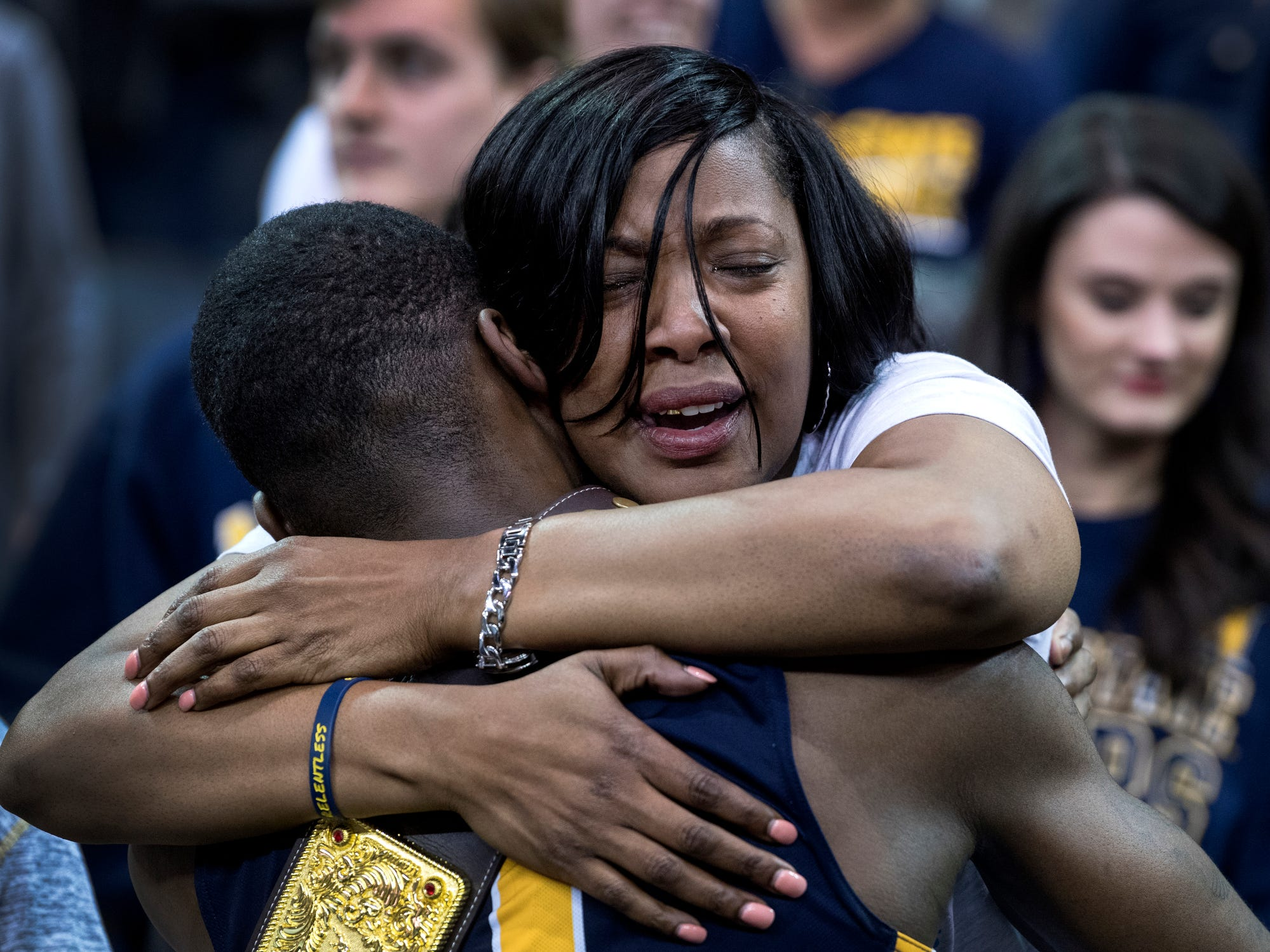Murray State's Shaq Buchanan (11) receives a hug from his mother Stephanie Latiker following the Racers' Ohio Valley Conference men's championship win over the Belmont University Bruins at Ford Center in Evansville, Ind., Saturday, March 9, 2019. The Racers earned the OVC men's championship title after defeating the Bruins, 77-65.
