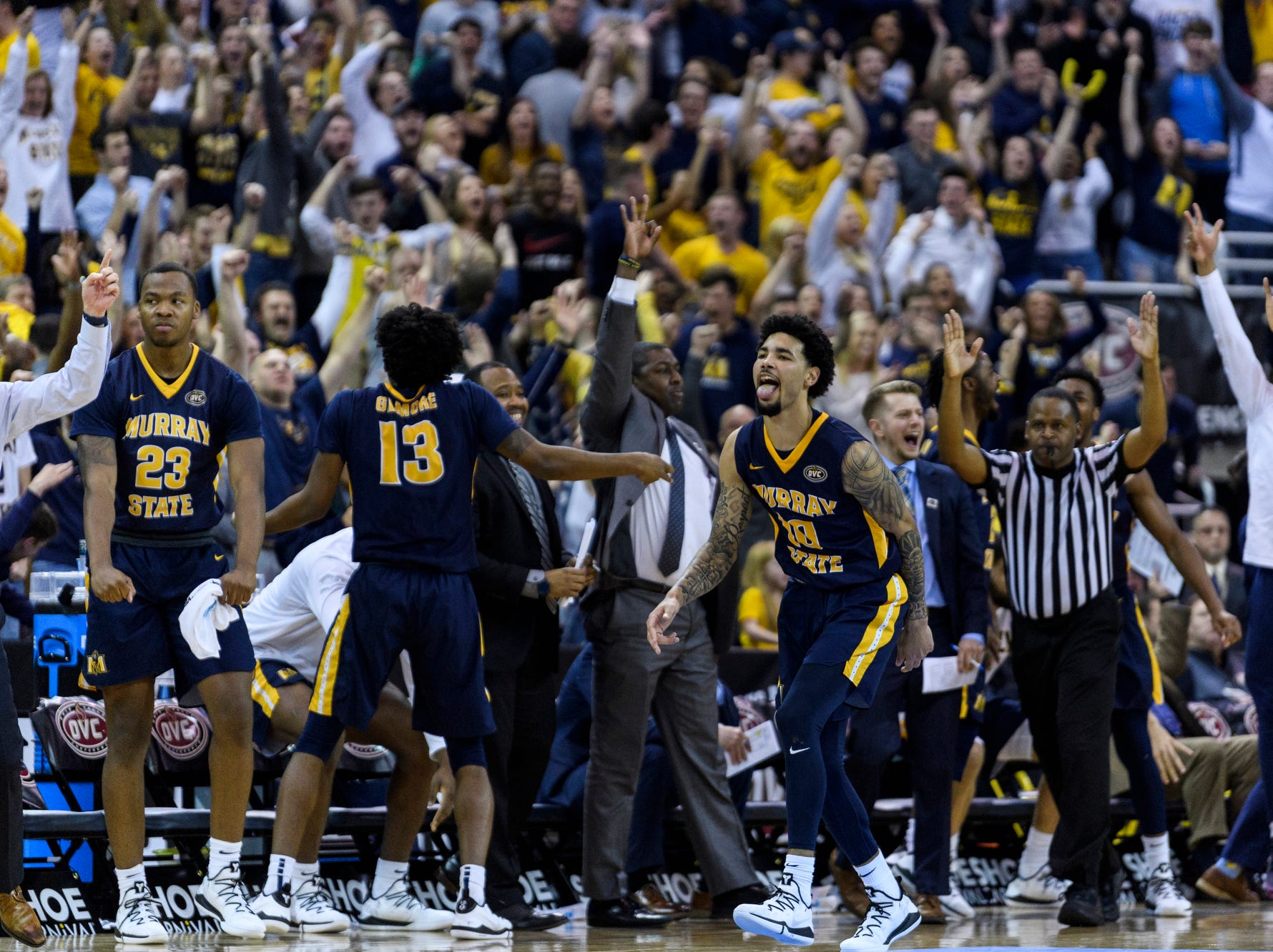 Murray State's Tevin Brown (10) and the rest of the Murray State University Racers cheer as they strengthen their lead over the Belmont University Bruins in the Ohio Valley Conference men's basketball championship at Ford Center in Evansville, Ind., Saturday, March 9, 2019. The Racers earned the OVC men's championship title after defeating the Bruins, 77-65.
