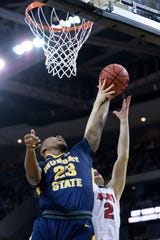 Murray State's KJ Williams (23) and Belmont's Grayson Murphy (2) fight for possession of the rebound during the Ohio Valley Conference men's basketball championship at Ford Center in Evansville, Ind., Saturday, March 9, 2019.