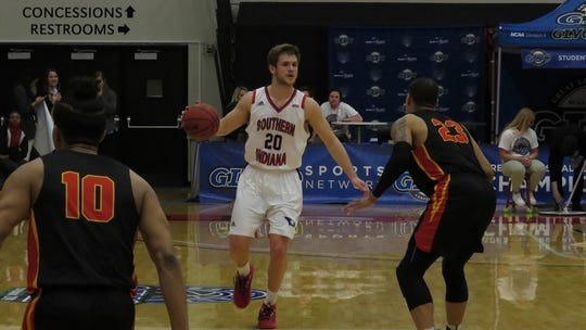 Alex Stein dribbles during USI's GLVC quarterfinal win over UMSL on Thursday.